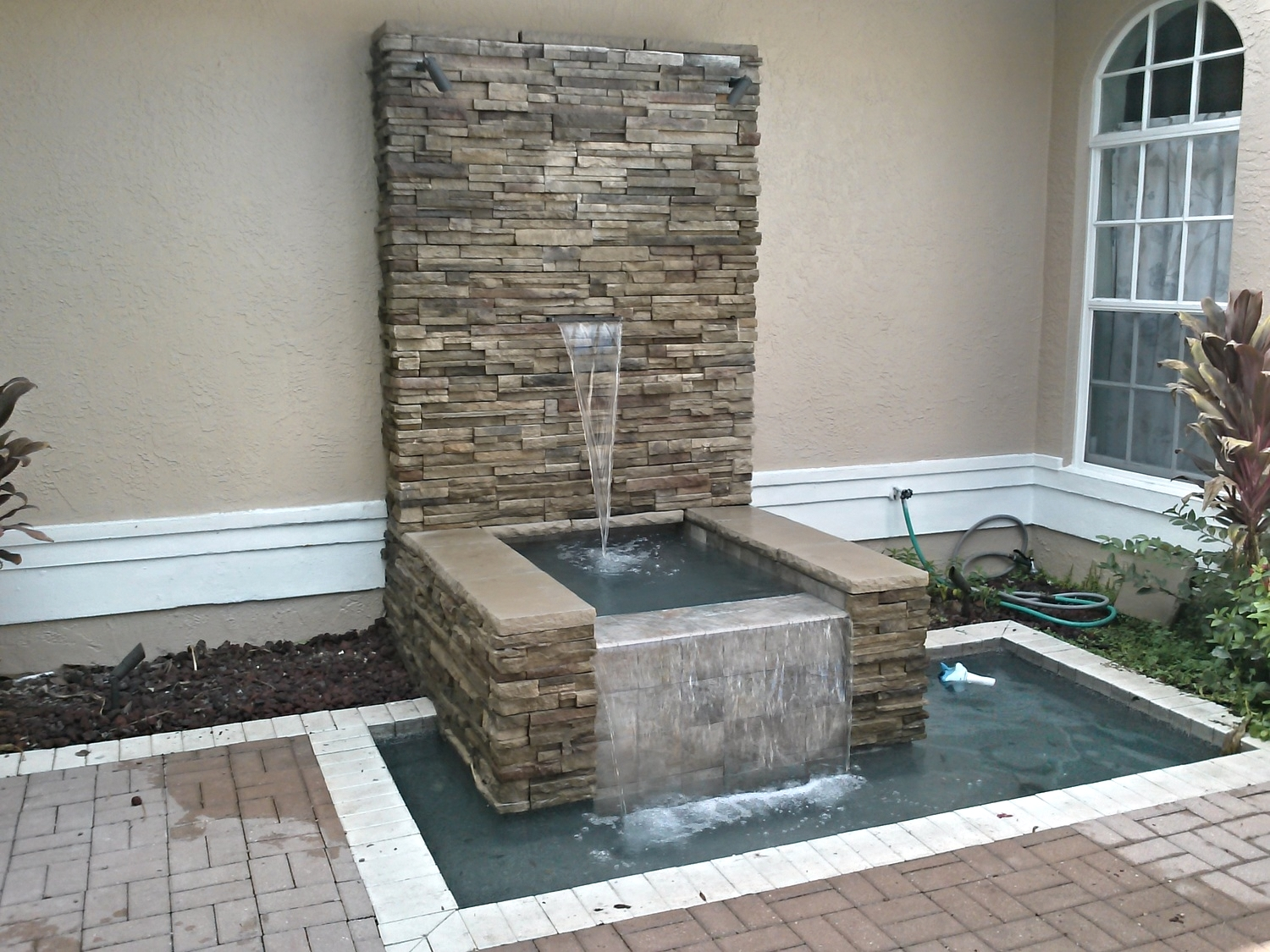 We modernized the water feature, and added matching stackstone to tie it in with the new feel of the living space.