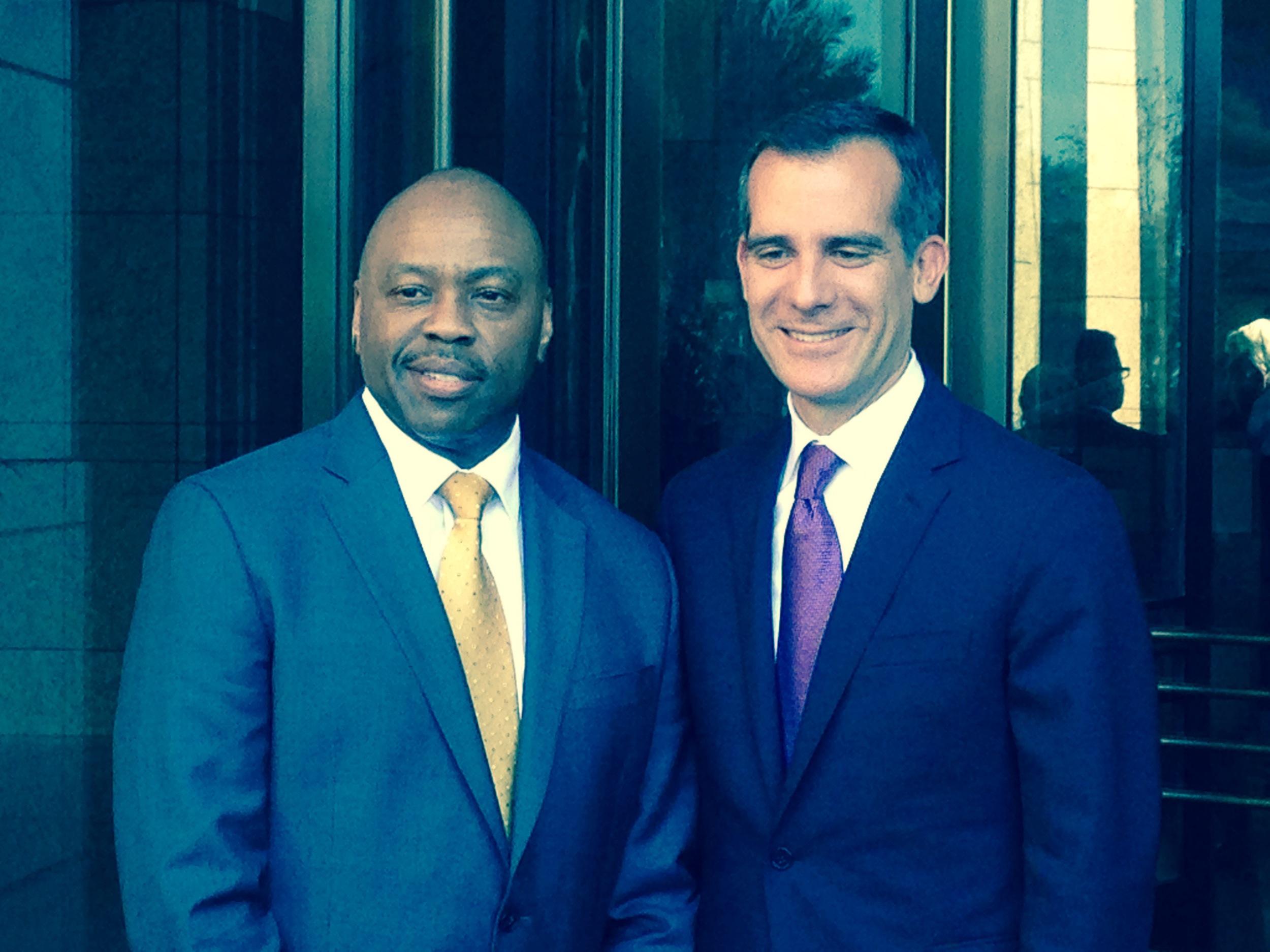 Phil Washington and Mayor Eric Garcetti pose for photos with the media.