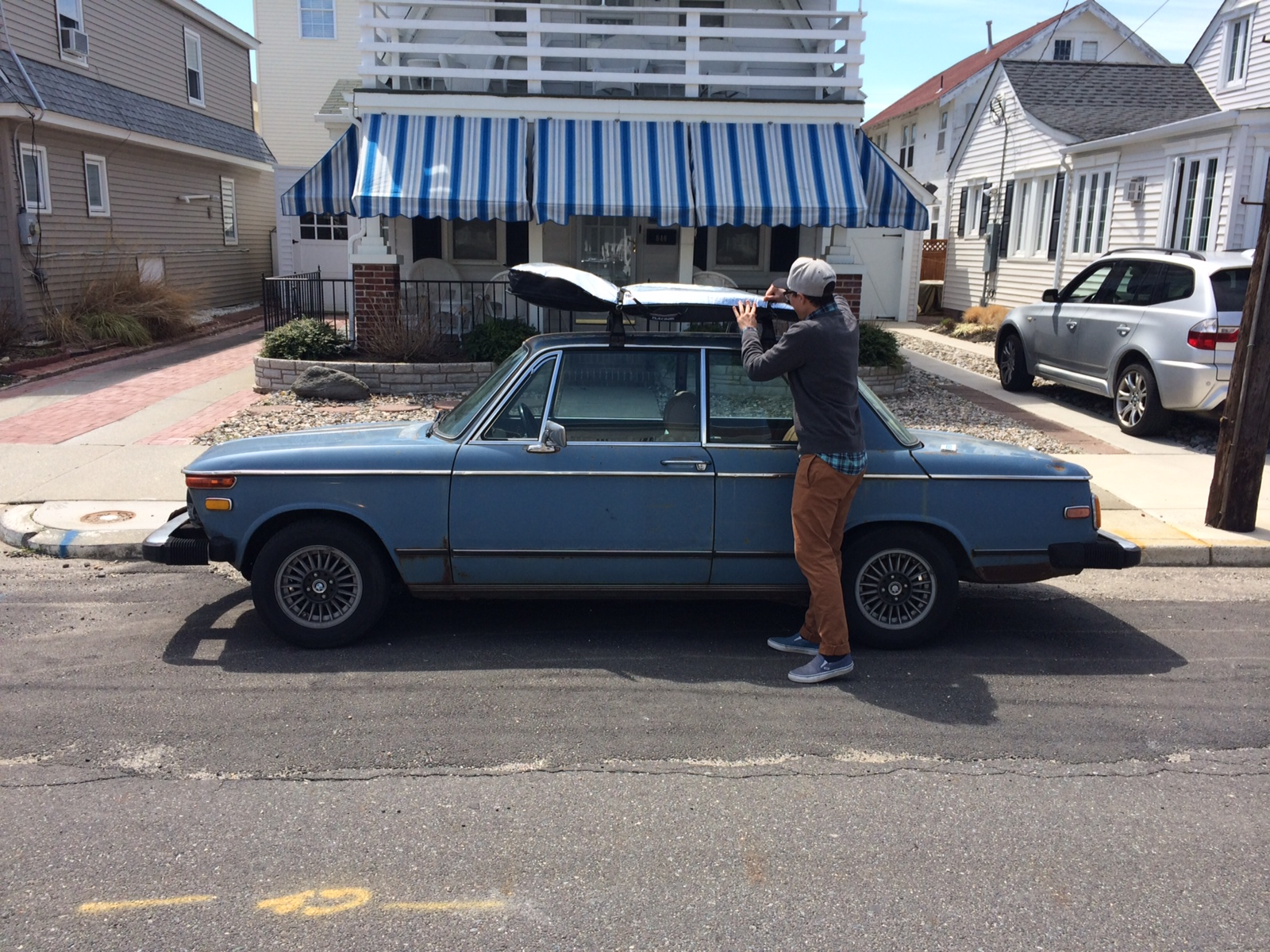 Dion strapping his board to the Conatus Surf Mobile -- a 1975 BMW 2002. If you take a lesson you will certainly see this car.