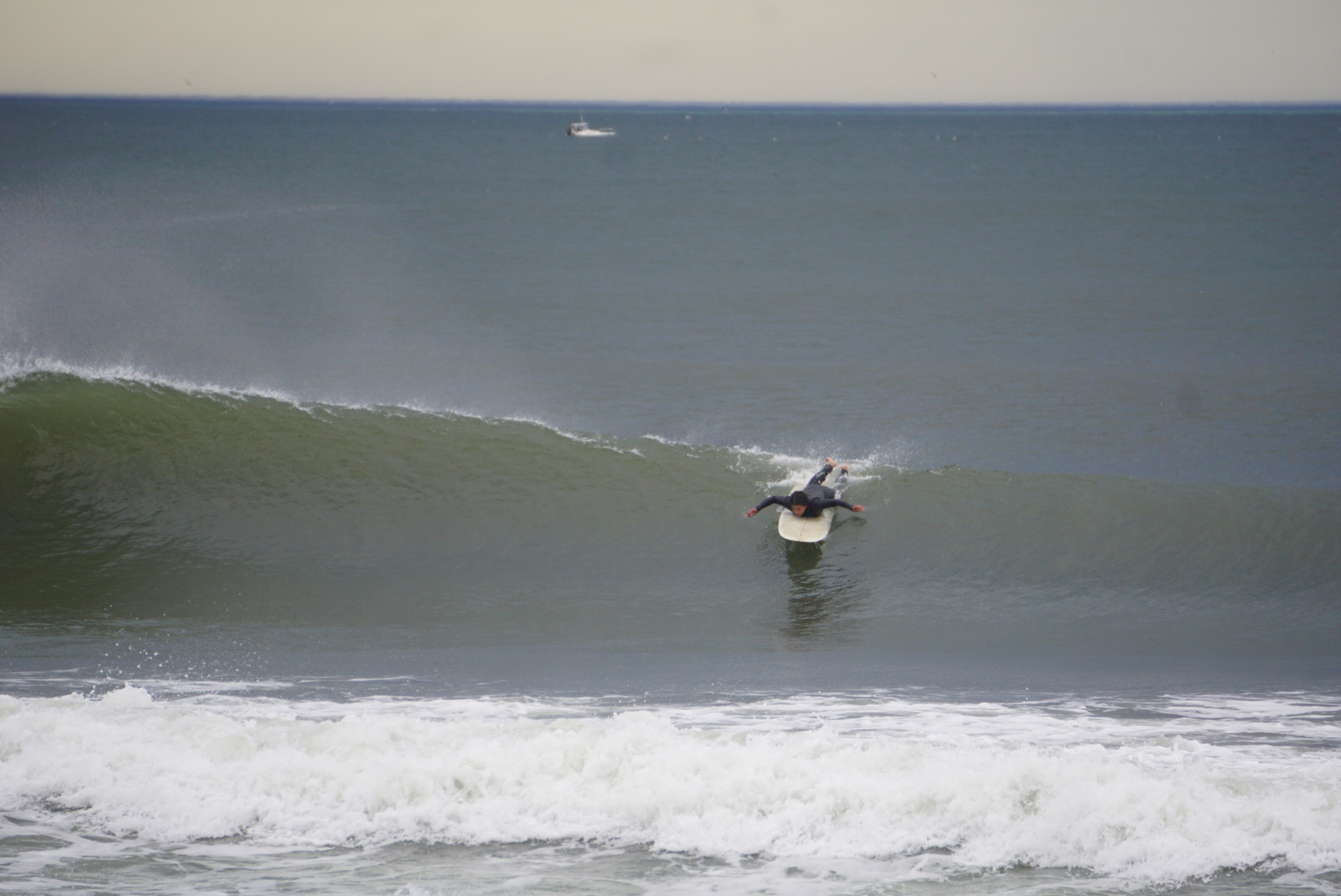 Christina paddling into a left. Photo: Dion Mattison