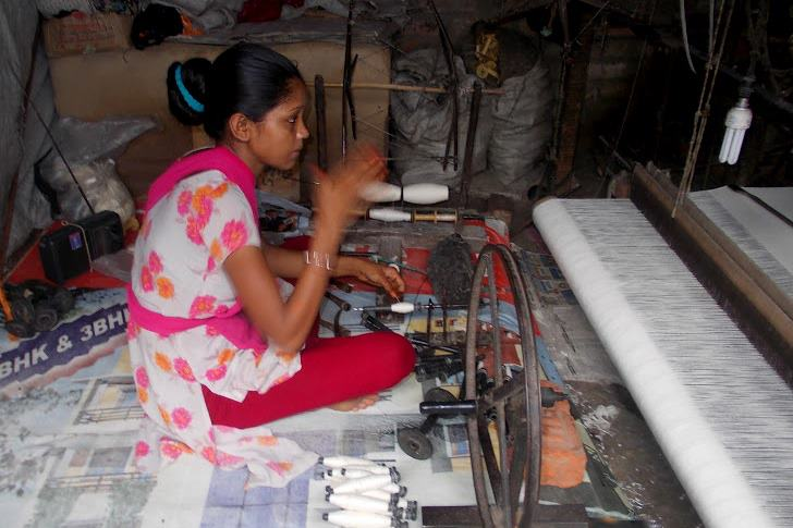 A woman spins bobbins (bottom, center) from a single yarn bundle.