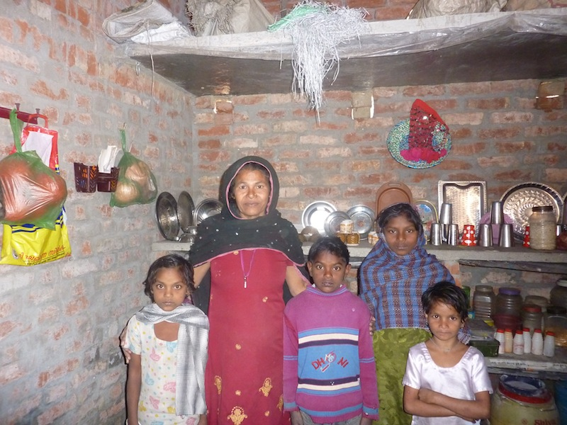 Husna with her grandchildren and neighbors' children in January 2012.