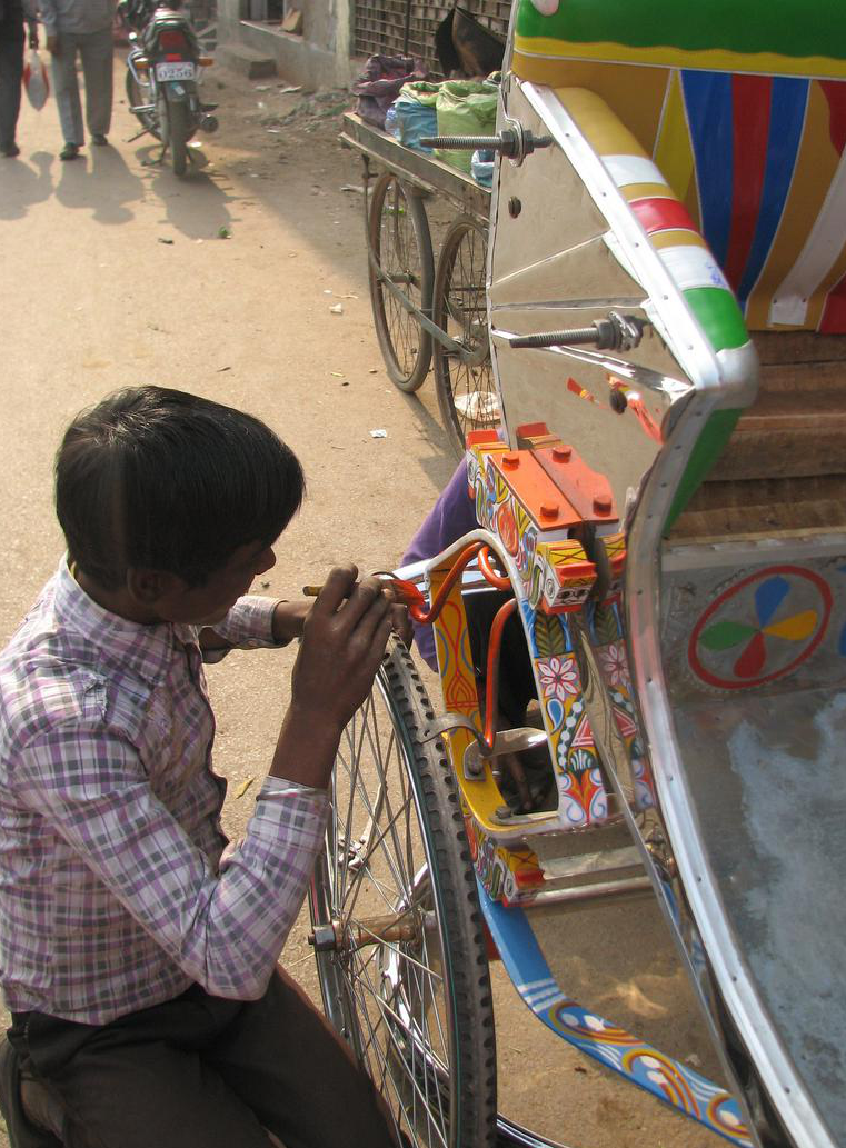 A worker with SMV Wheels maintains one of the many rickshaws in the fleet, which employs hundreds of rickshaw pullers. (Image credit: SMV)
