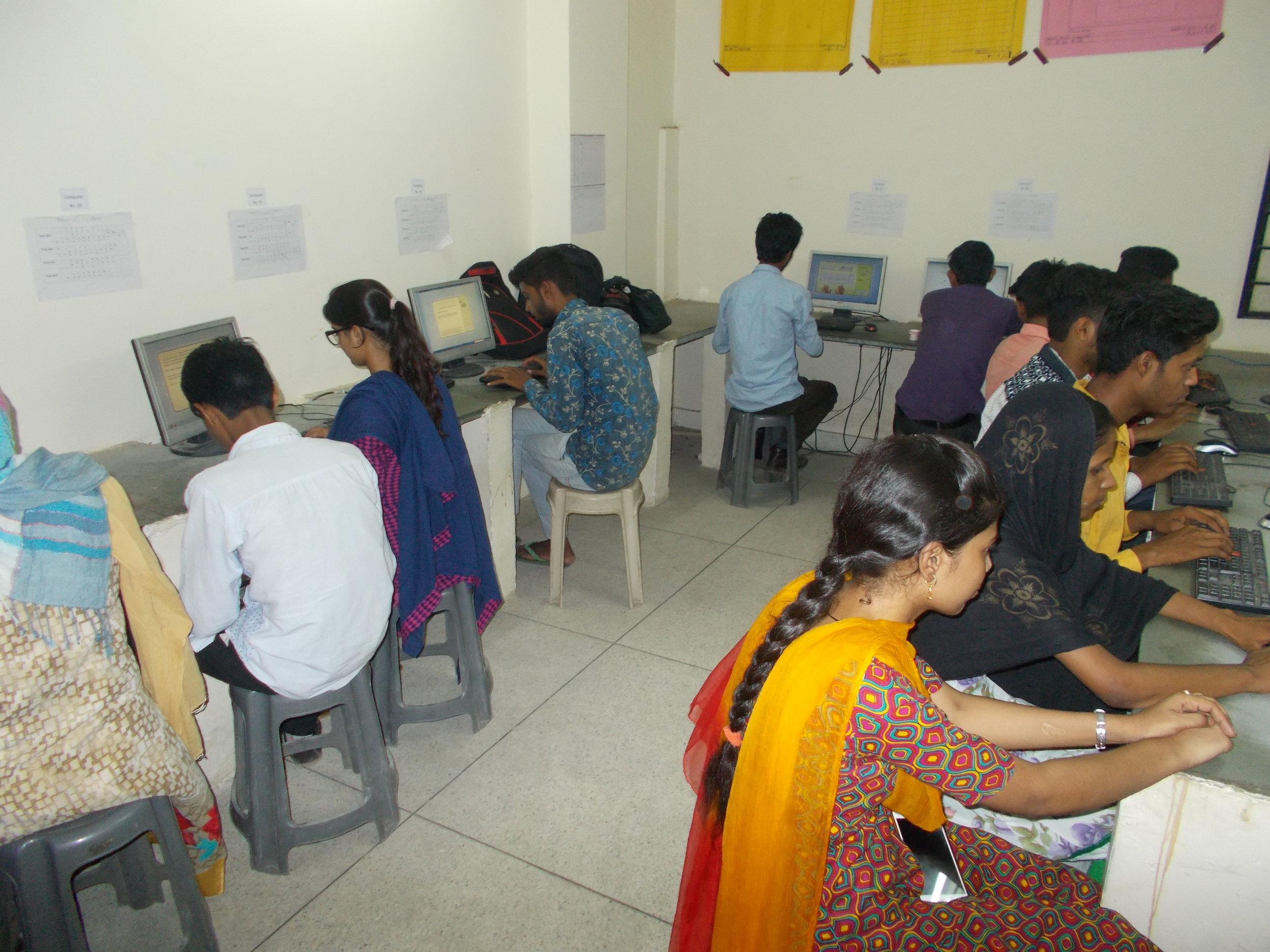 Students learning computer skills through UpSkill's technology-based vocational training platform.