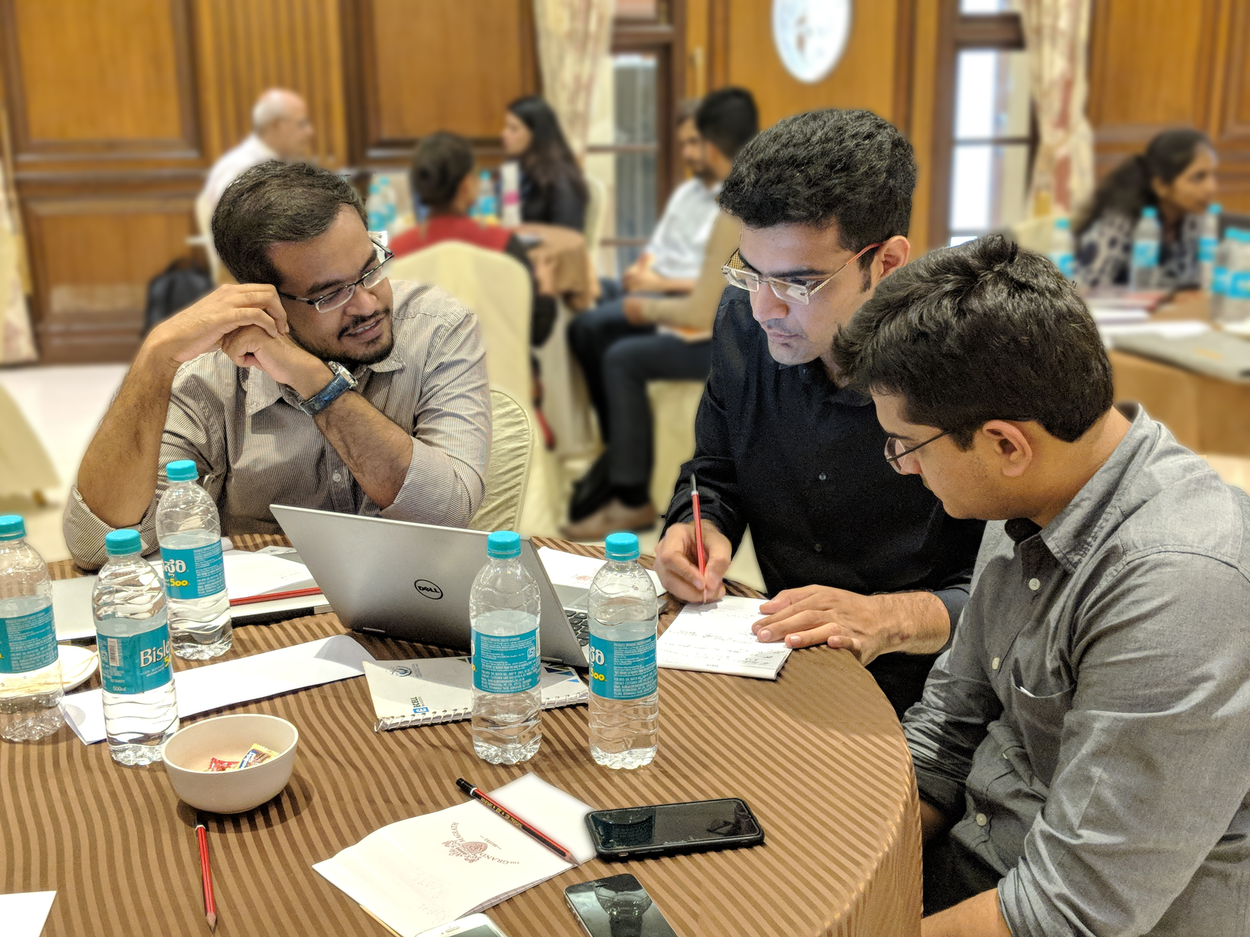 Kunal Bhatia (center) and Shagun Setia (left), work through their financial plan with their mentor, Shreyansh from Ankur Capital.