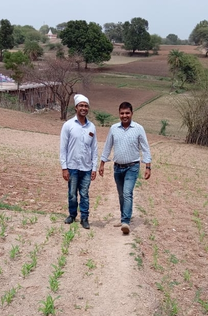Sushil Taank giving Upaya's Amit Choudhary a tour of the farm.