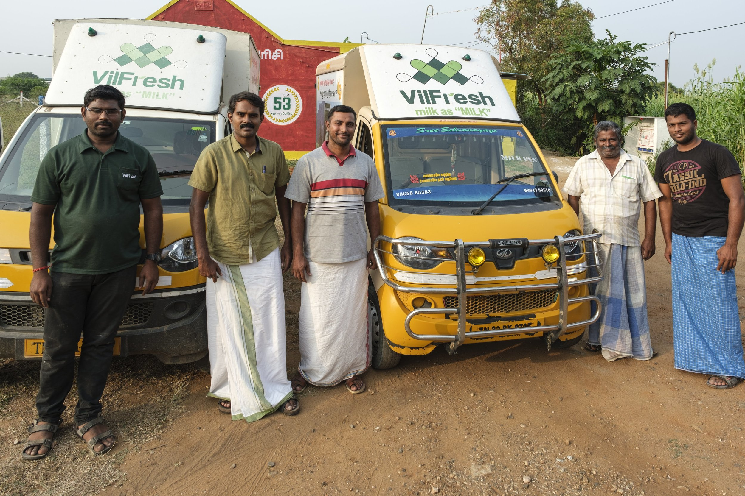 Selvakumar Varadharajan (second from the left), founder of Laymen Agro, with his team in front of Laymen Agro's Vilfresh trucks used to pick up milk from surrounding farms.