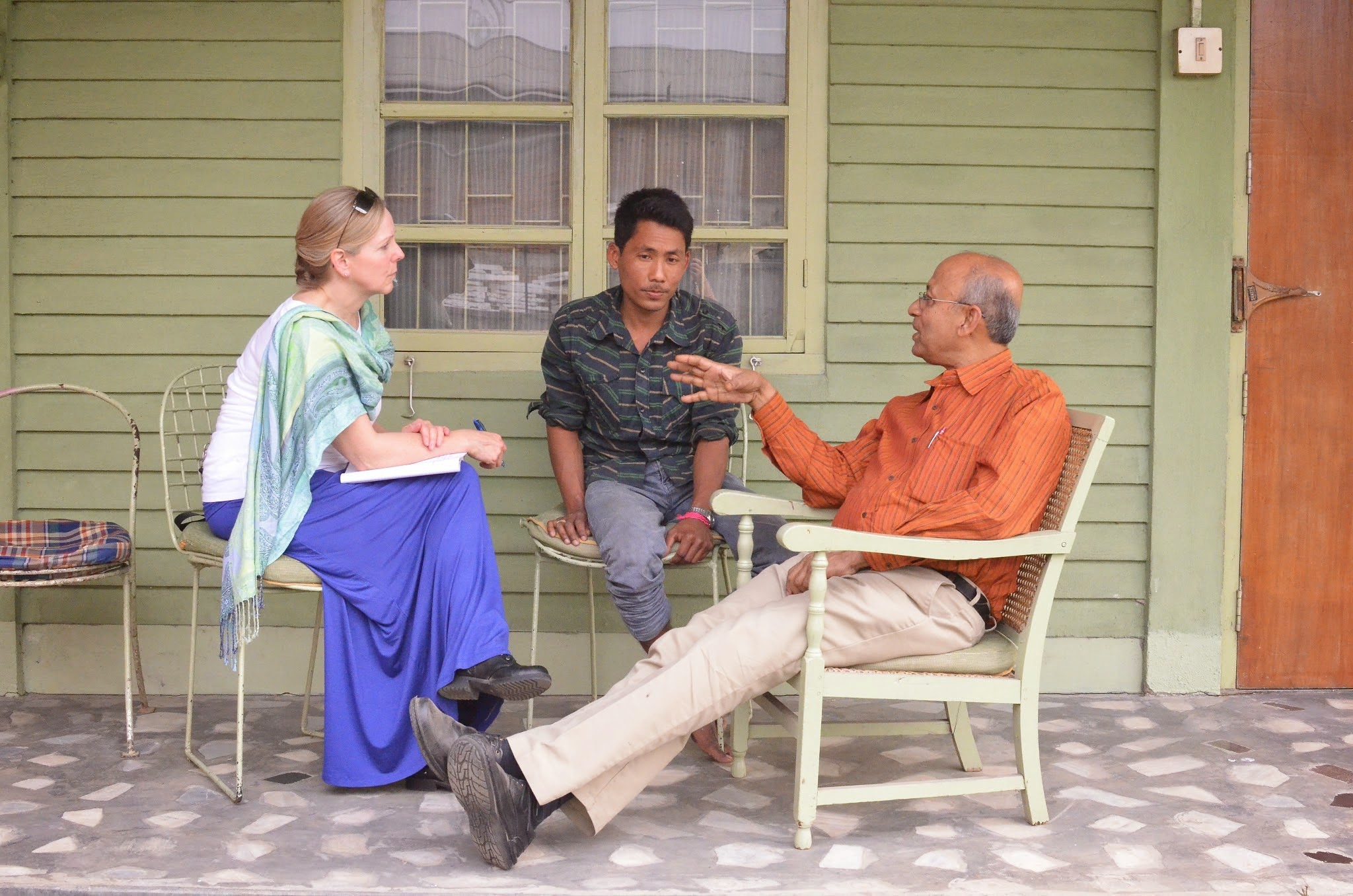 Founding funder, Suzanne Skees of the Skees Family Foundation (left) talking with the Co-Founder of Elrhino, Mahesh (right), and a jobholder of the company (center).