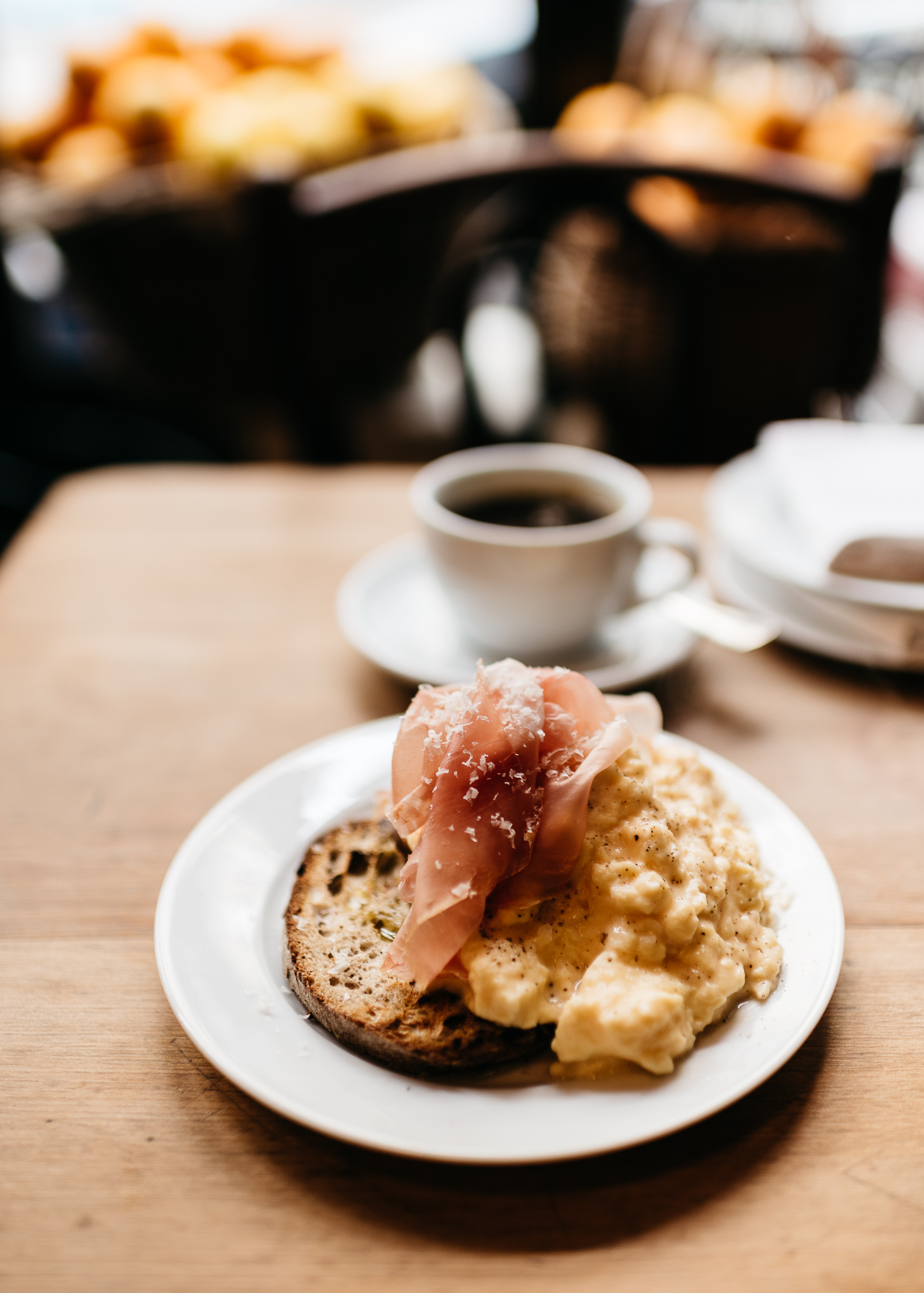 Steam scrambled eggs and prosciutto on grilled bread at Buvette Paris