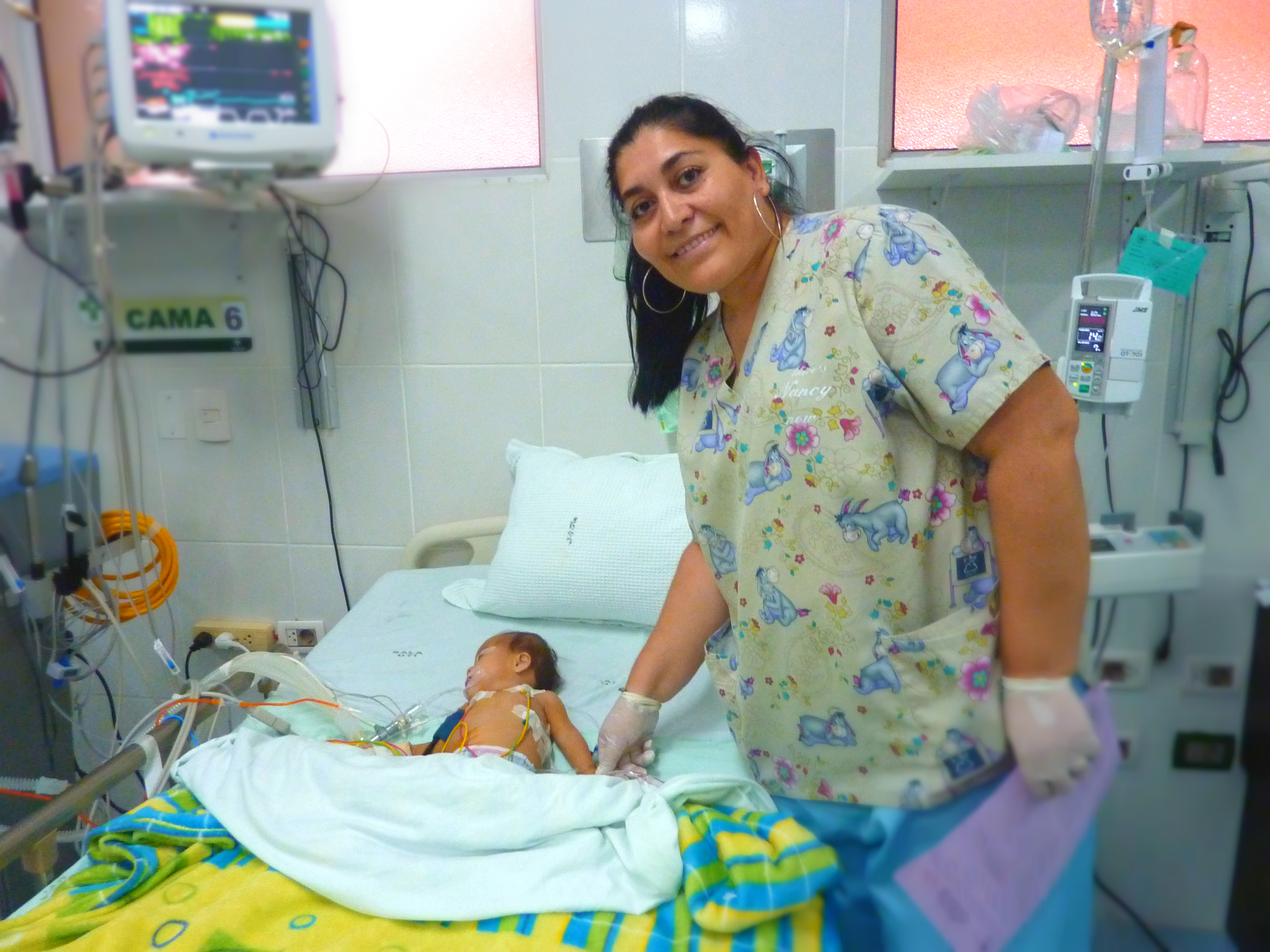 Nancy is a post-op nurse with a full-time job at a private hospital. She puts in a second shift at the Hospital de Niños to support and train the new unit's nursing staff.