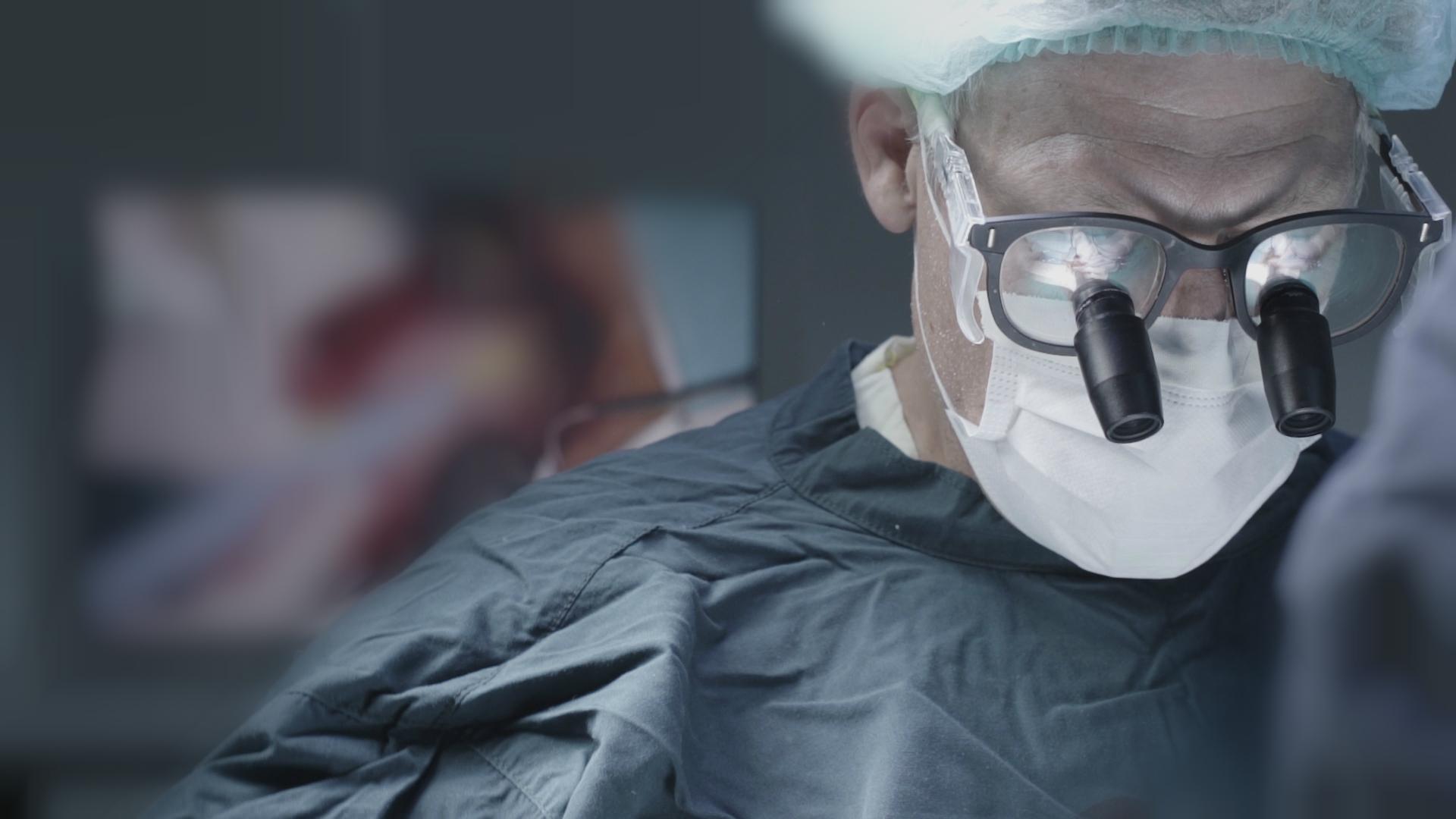 Neurosurgeon Dr. John Weaver in surgery.