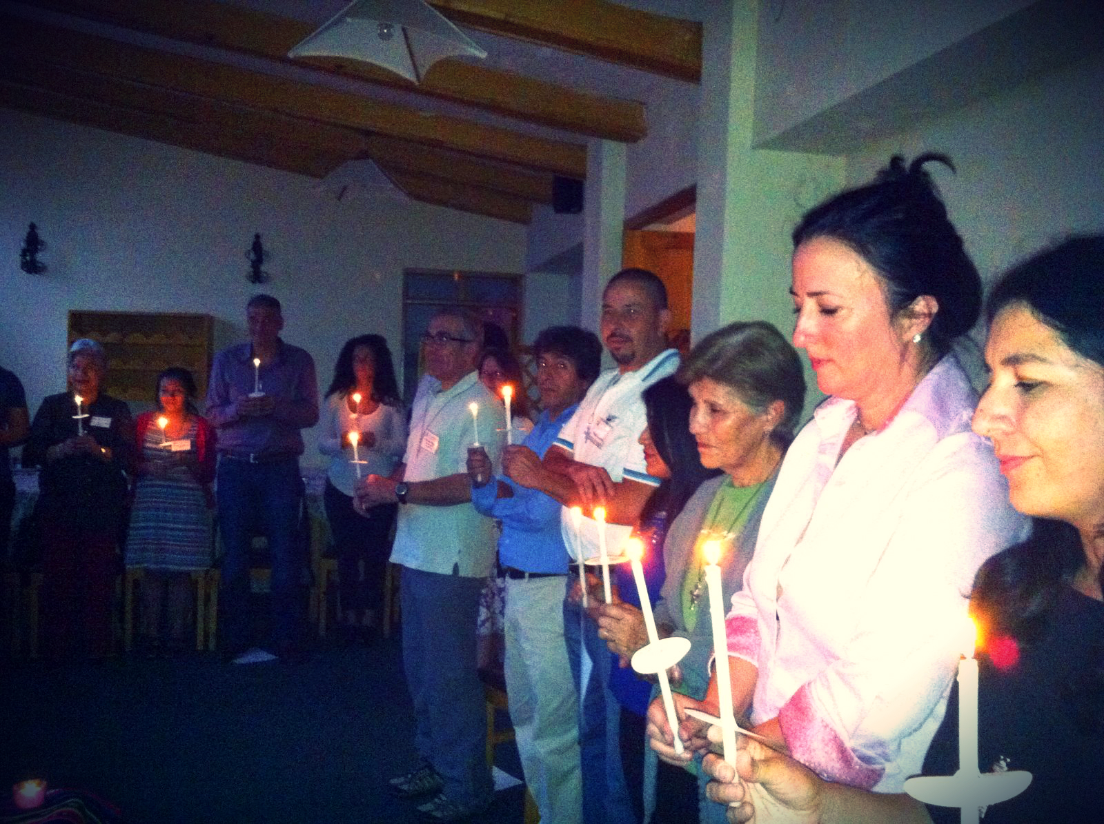 Missioners participating in the candle lighting ritual during the trip's opening ceremony.