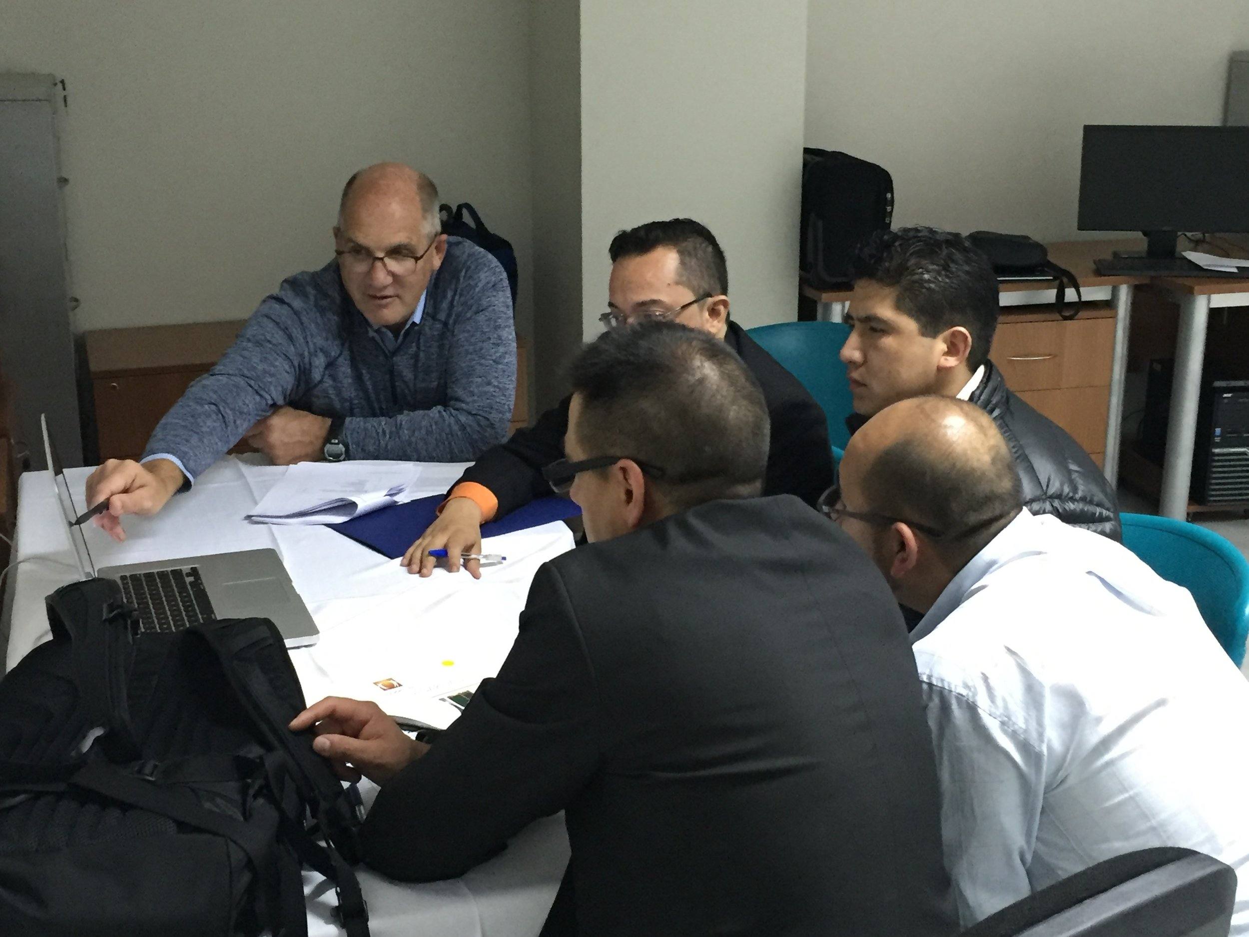 Dr. DiPatri (left) discusses a case with with Bolivian doctors during our Neurosurgery Boot Camp training.