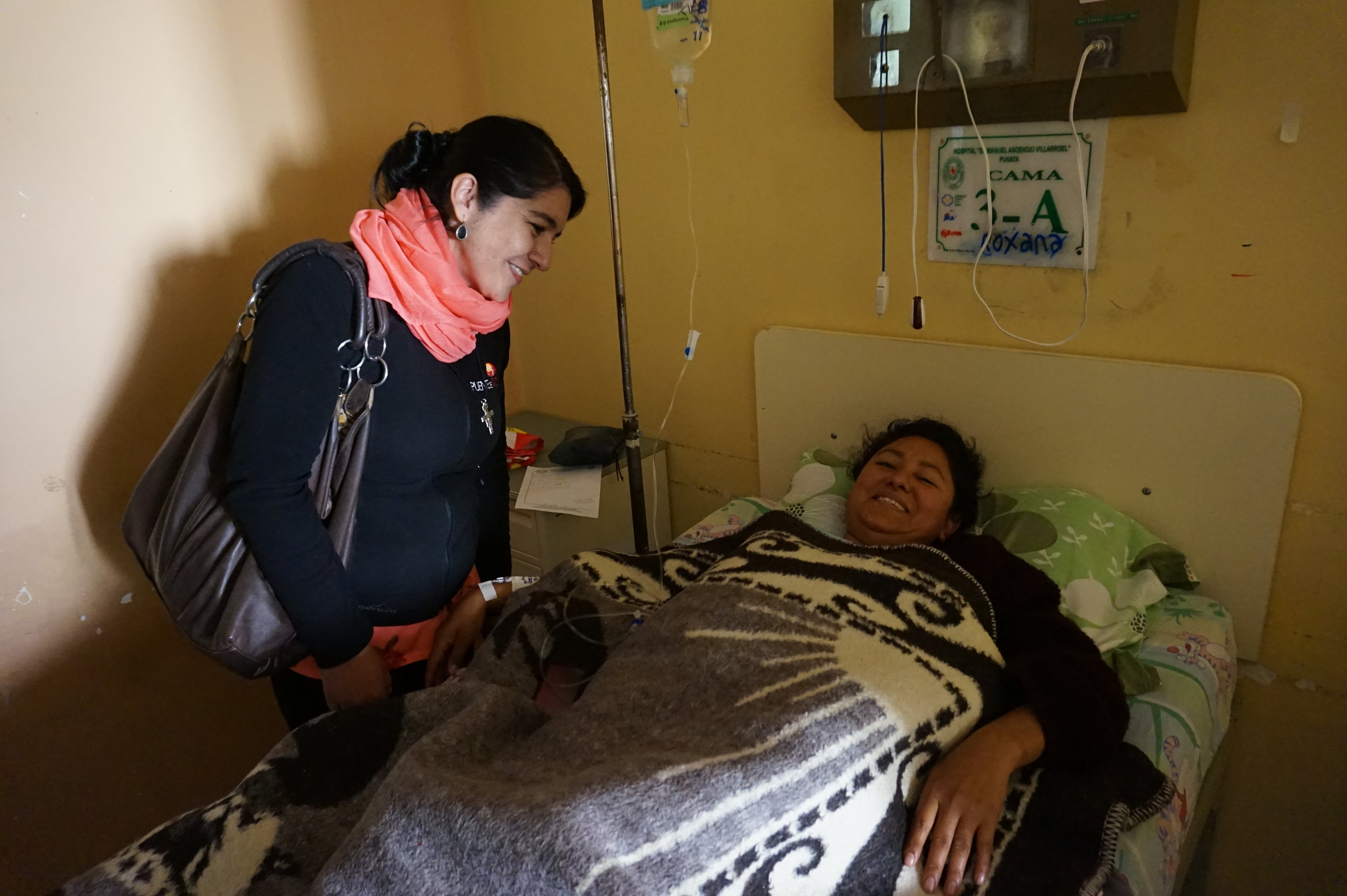 Marcela visits with hospital patients.