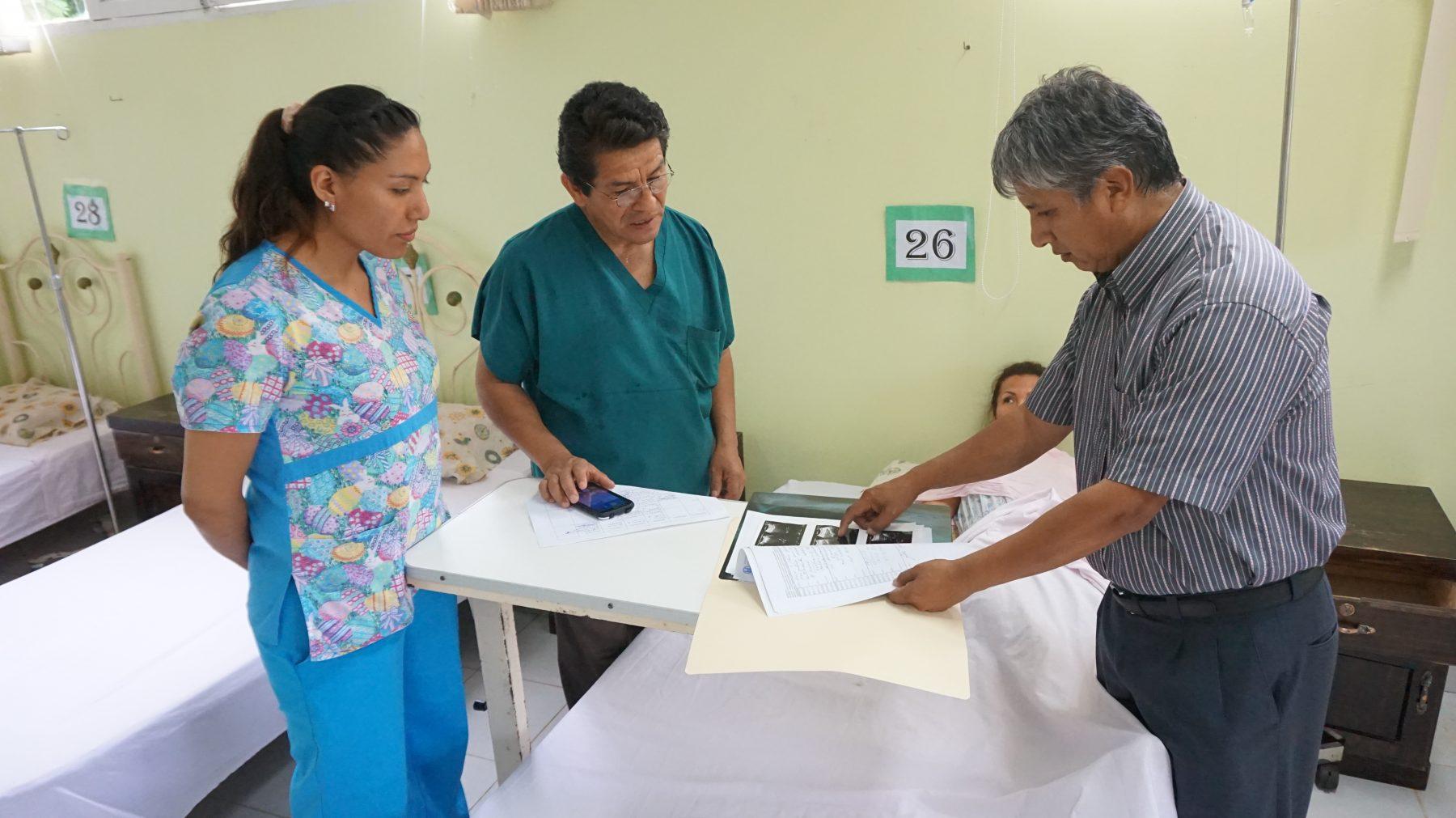 Doctors discuss the patient's chart