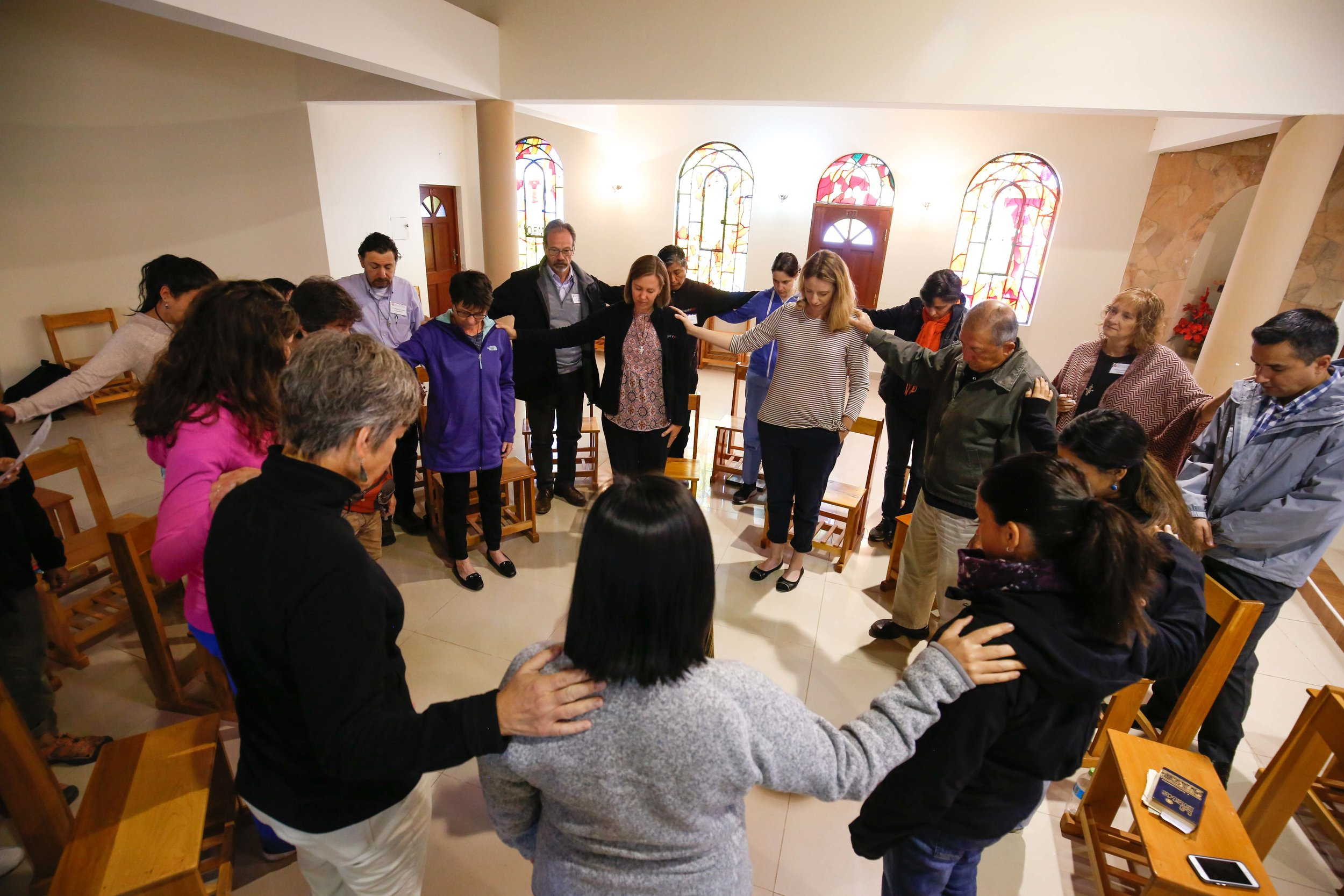 Missioners gather in prayer before their work begins at the hospital each day