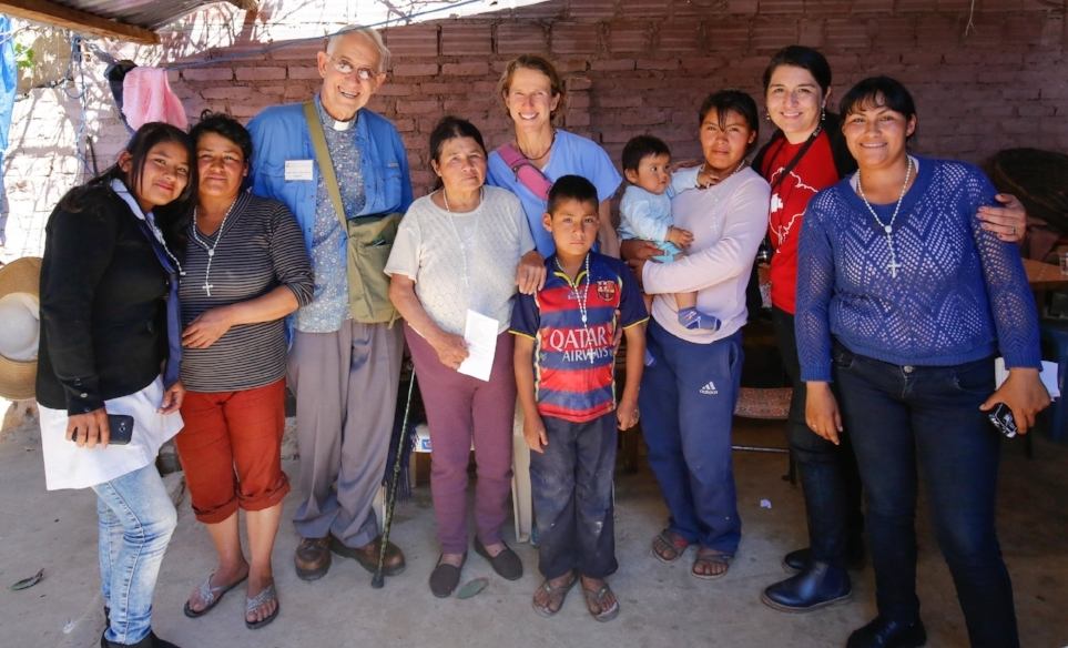 Esperanza and her family at home with members of the Multi-Specialty Mission Team.