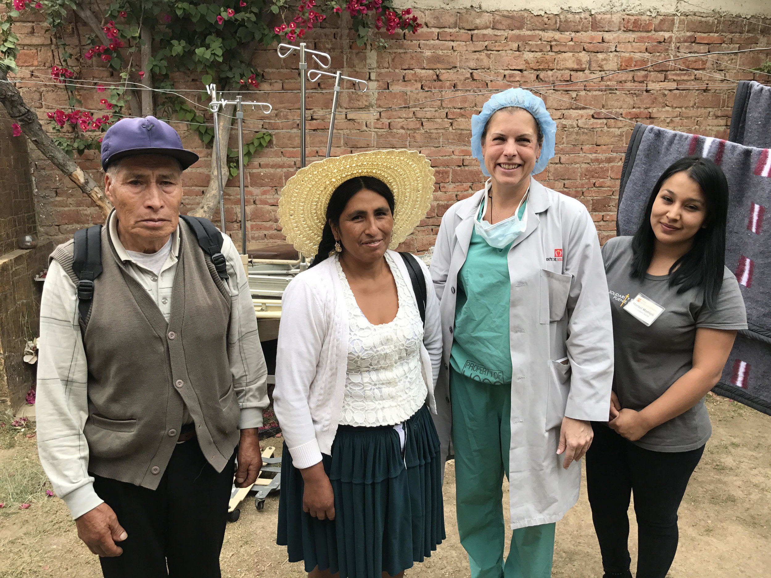 PdS social worker Marizol Mamani (far right) with Dr. Janet Tomezsko and a patient and her family member during the 2017 Gynecologic Surgery mission trip.