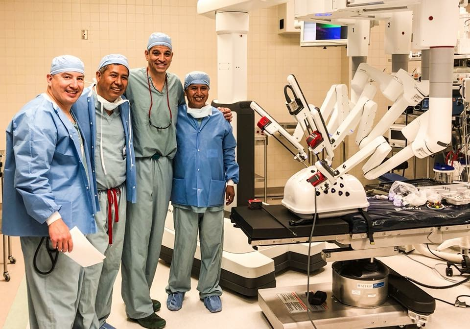 Posing with the da Vinci robot, a type of surgical technology