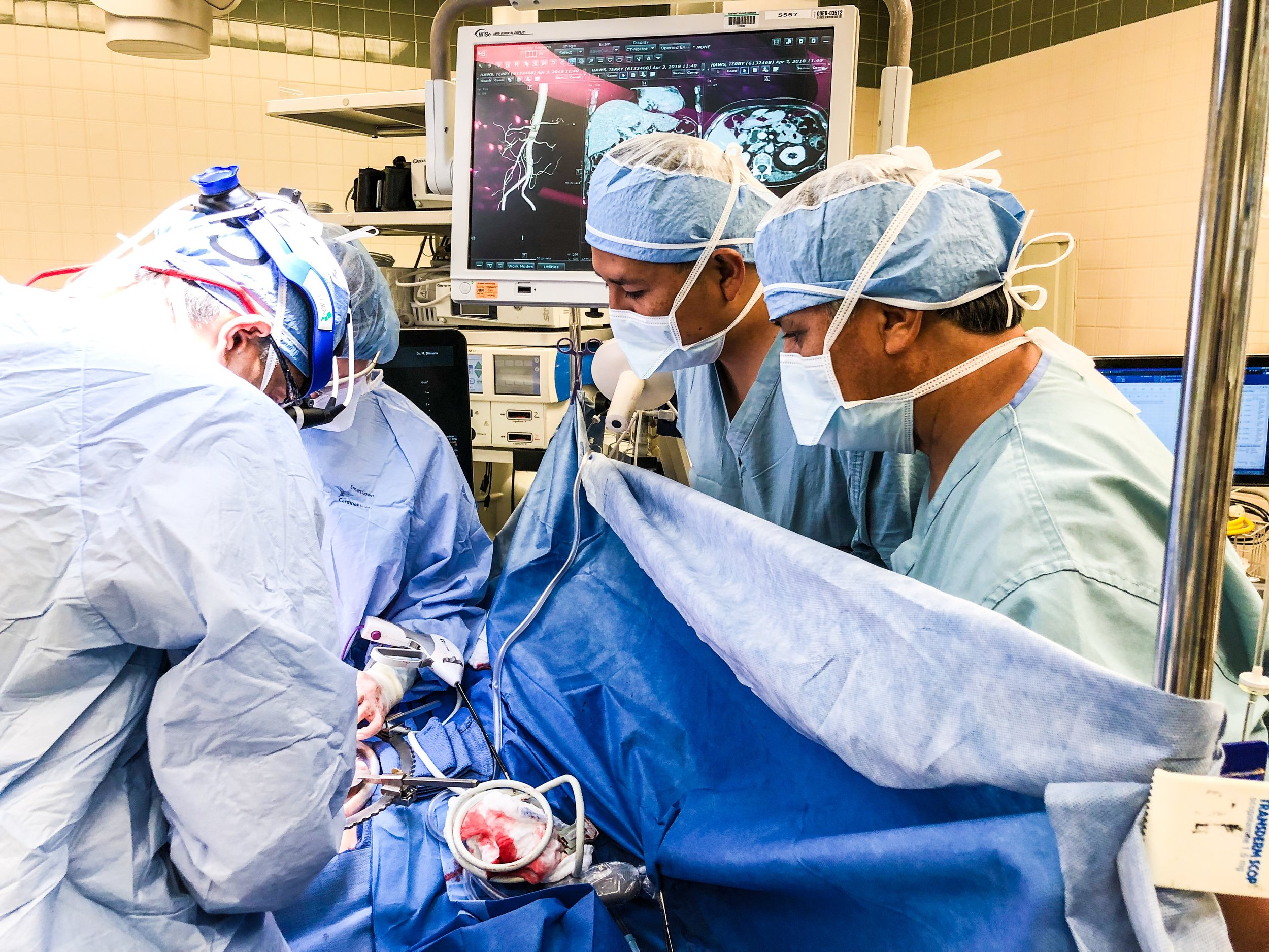 Drs. Vallejos and Camacho observe Dr. Bilimoria in the O.R.