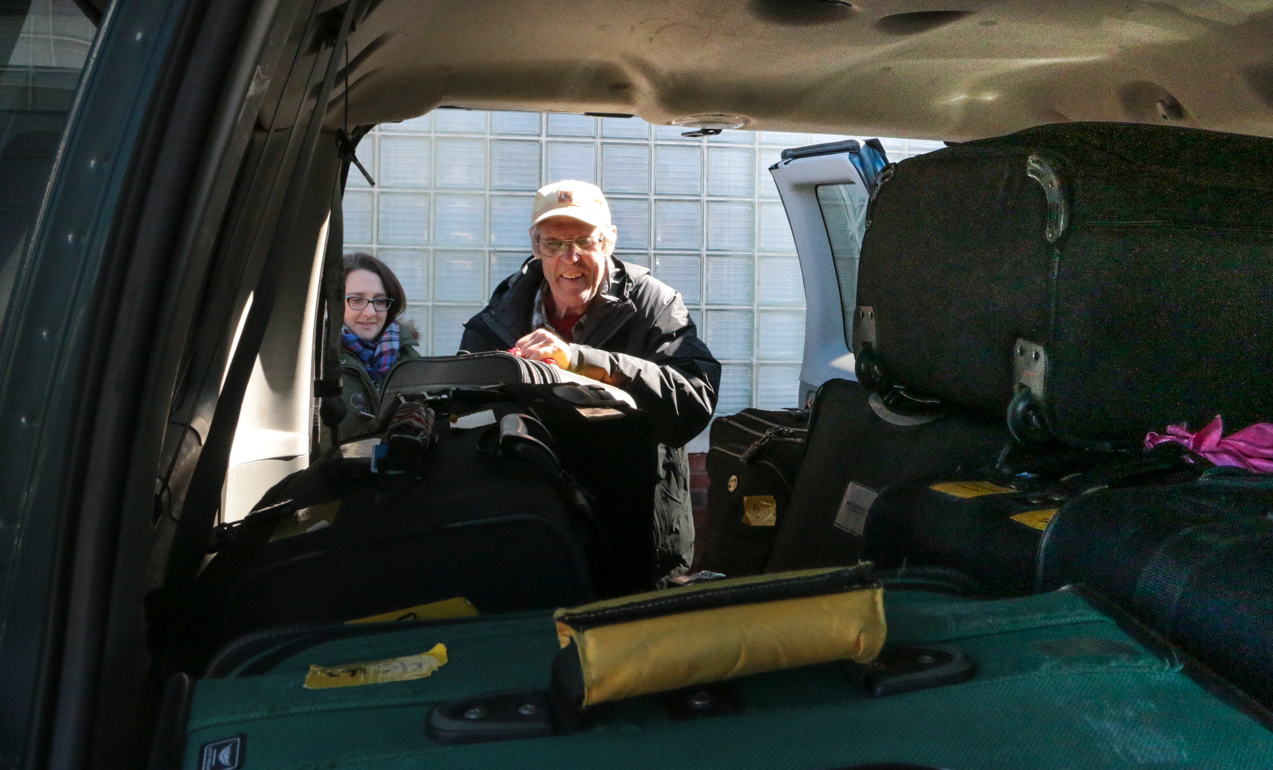 Airport Pick-Up - How do we get 16 suitcases and two missioners to the airport? Call Pat!