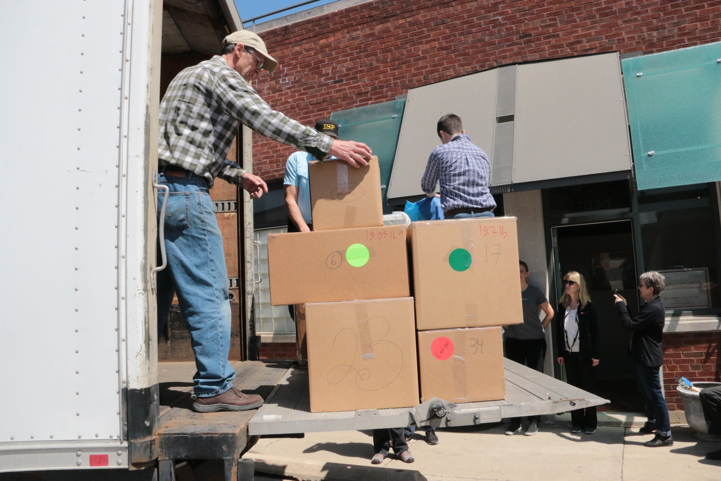 """Loading a Shipping Container - Pat has also been on hand for several """"container loading days"""" when we pack hundreds of boxes onto a trailer truck to be shipped to Bolivia. Thanks Pat!"""