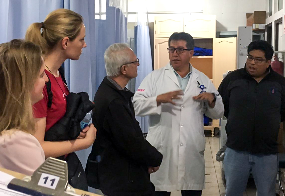 The mission team interviews Dr. Marcelo Valdivia regarding current capacity in the Santa Bárbara Hospital's Emergency Department.