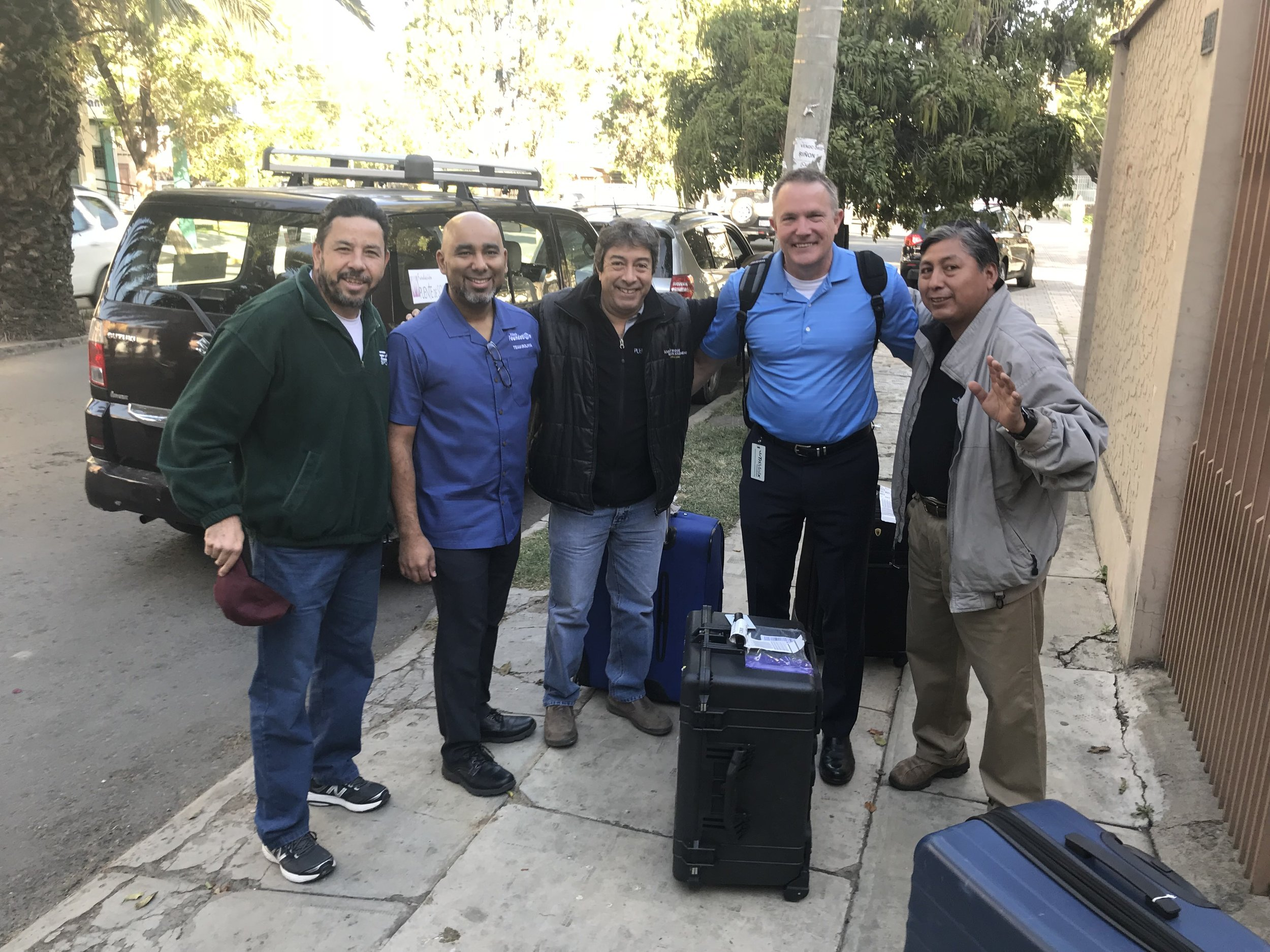 Our missioners (in blue) are greeted by colleagues at the Puente de Solidaridad office.