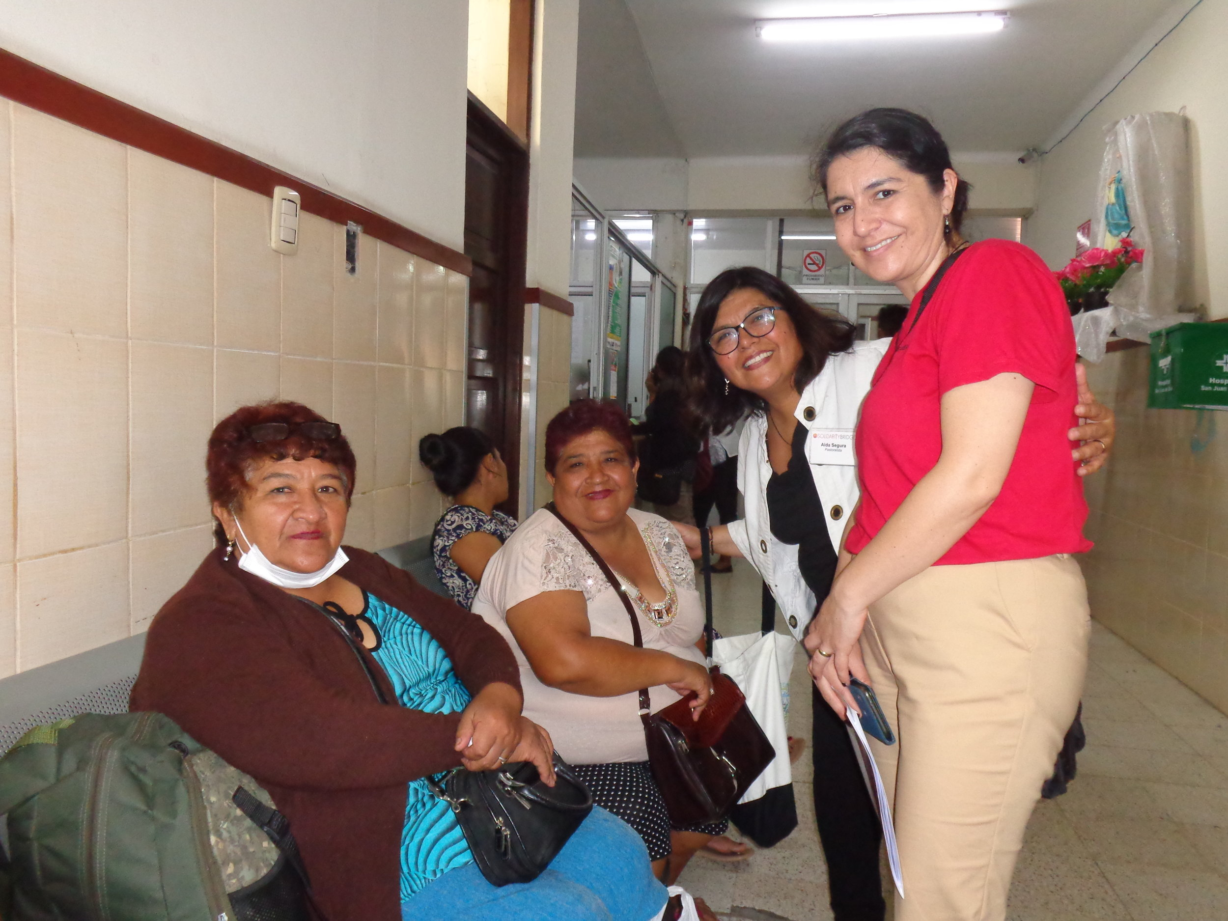 Aida (second from right) visits with patients in the halls of the San Juan de Dios Hospital