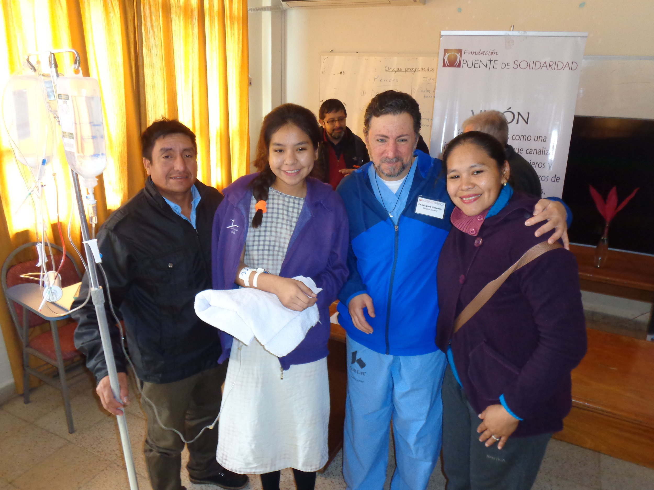 Ana Paola (second from left) is pictured here with her parents and US missioner, Dr. Magued Khouzam.