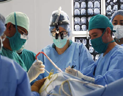 Dr. Robert Glick (center) operates with her Bolivian peers in 2006 to repair Gardenia's spine.