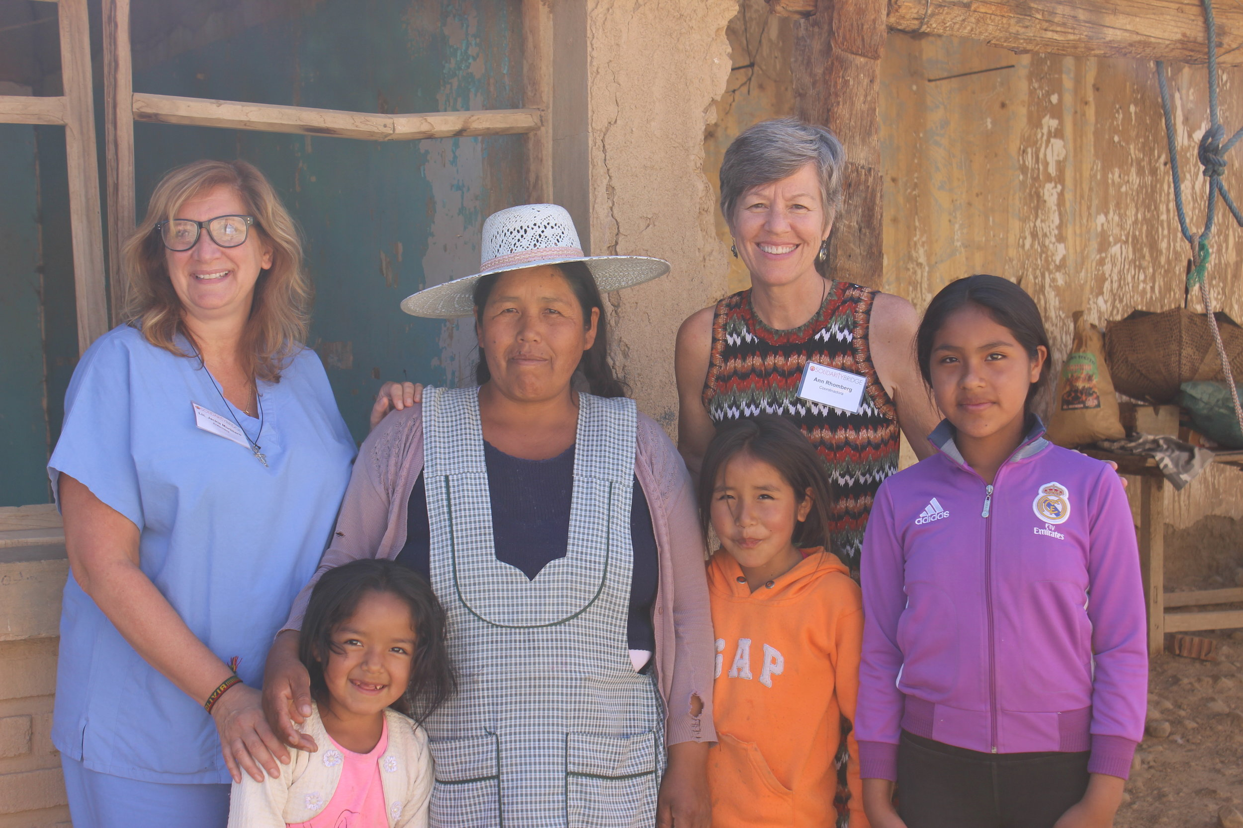 Two of our missioners visit with Sarah and her daughters at their home.