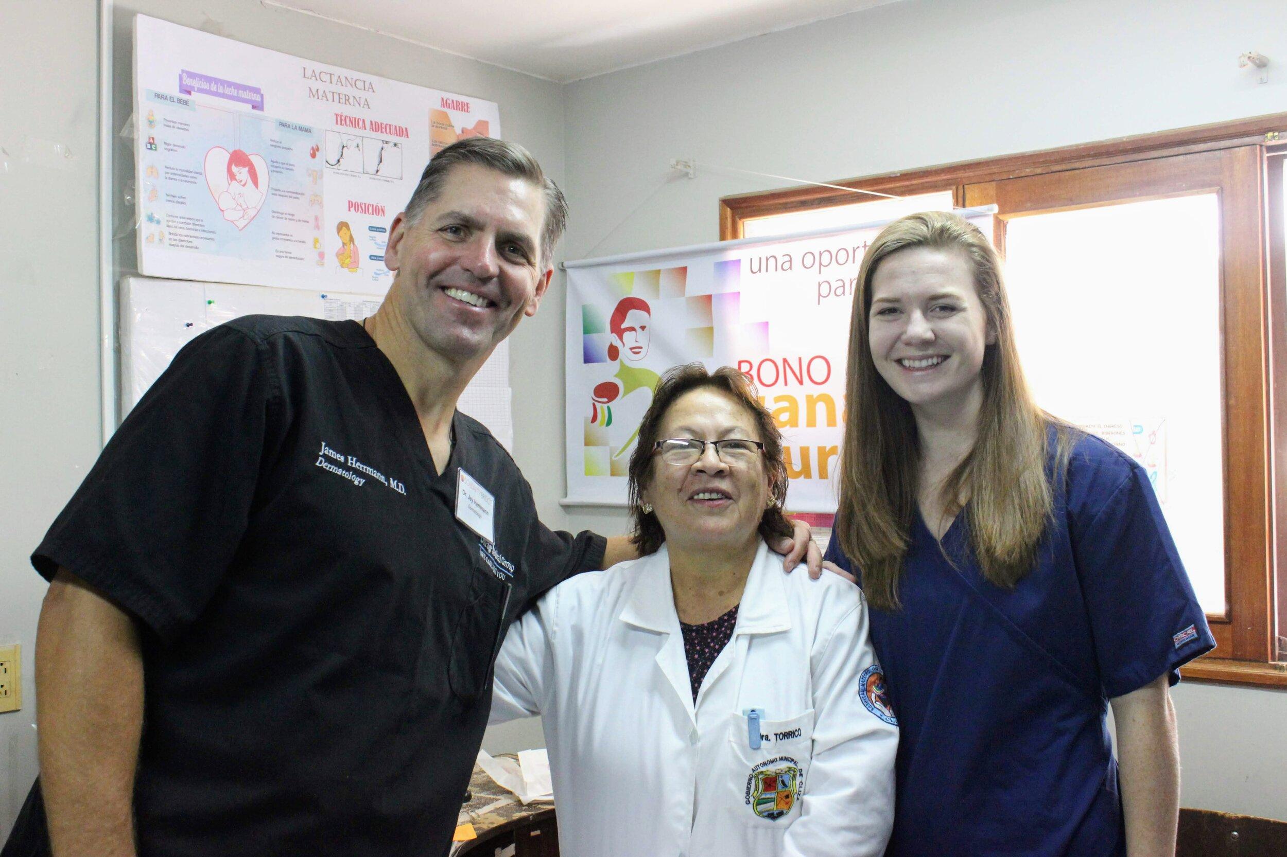 Dr. Herrmann, Dr. Torrico, and their interpreter, Carlin