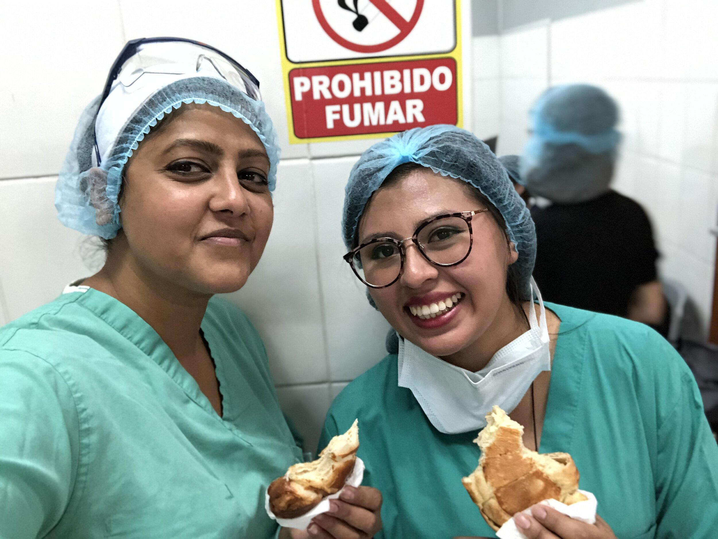 Dr. Shelly and her interpreter Dr. Denise take a quick snack break, enjoying a Bolivian salteña.