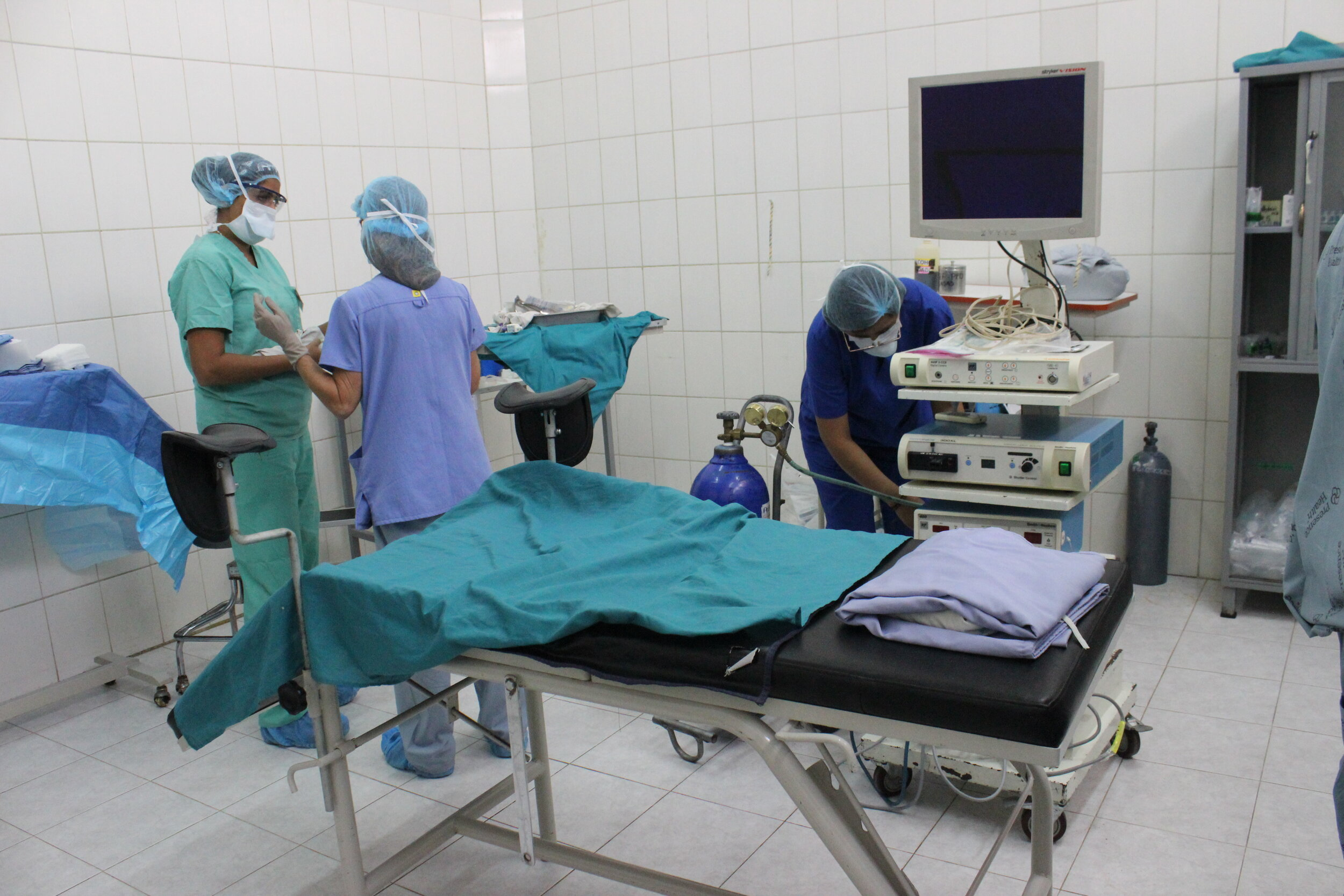 consulting with her fellow missioner, Surgical Nurse Jen, as they prepare the OR