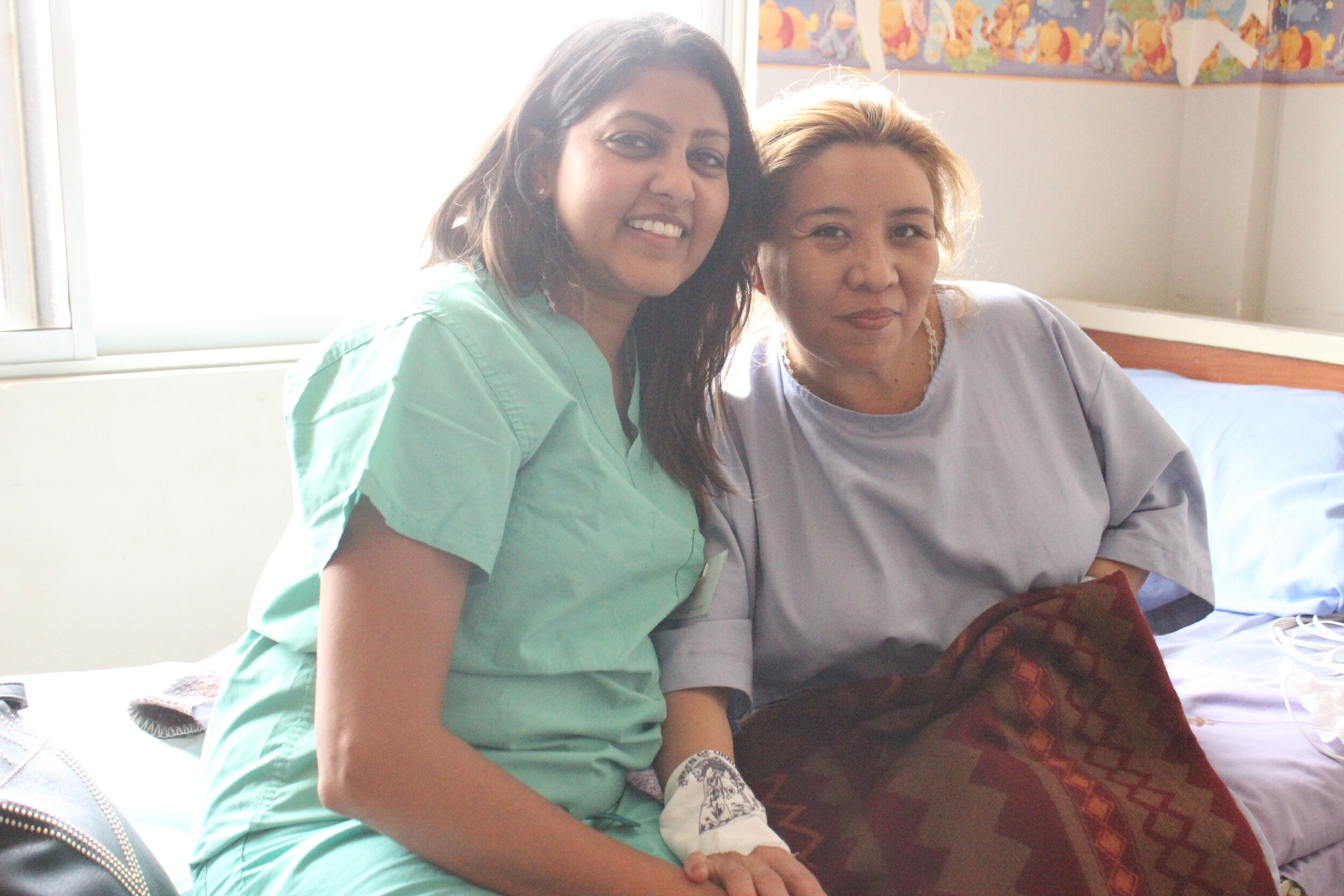 Shelly visits with one of her surgical patients, Galia.