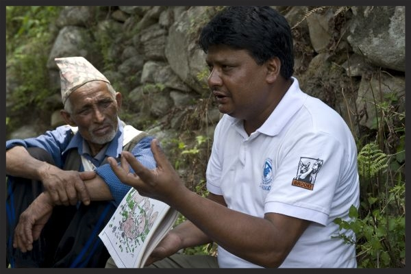 A Brooke Nepal Animal Welfare Facilitator explains the importance of Tetanus vaccinations to a group of equine owners.