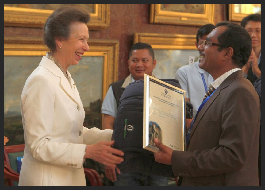 Her Royal Highness Anne - The Princess Royal (daughter of Queen Elizabeth II) presents Brooke veterinarian Dr Jogen Kalita and his team with the award for Best Research Poster (Project) at the 2014 International Colloquium on Working Equids.