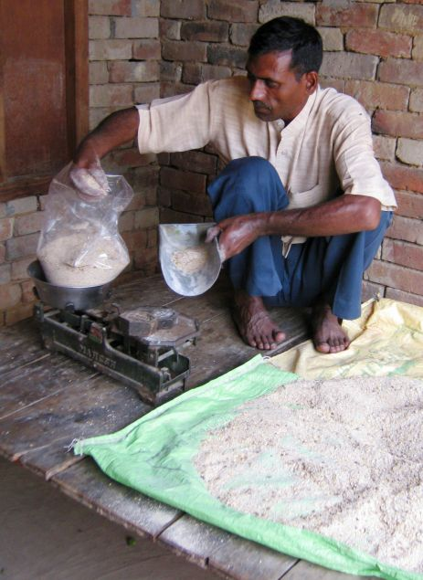 Desh Raj making up his feed mix at his shop in Goyali village, India. Equines working during the brick kiln season require fortified feed, particularly a mix higher in protein and energy. After attending a Brooke talk for equine group leaders, local shop owner Desh Raj was convinced he could produce a cost-effective energy-efficient feed, and with some advice from Brooke Veterinary Officer, Dr. Vaibhav, Desh Raj prepared a mix feed incorporating five grains.