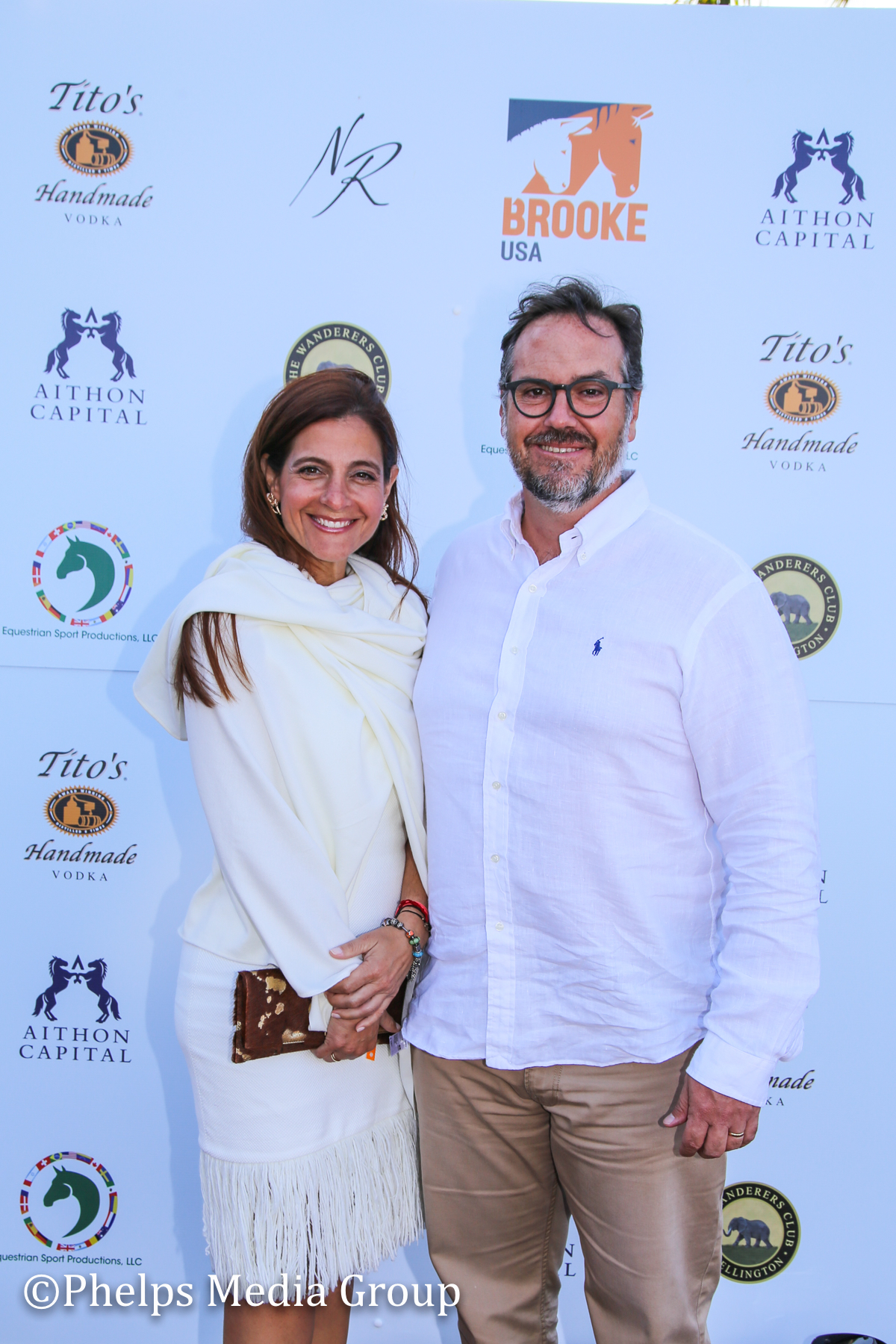 Enique and Maria Urdaneta; Nic Roldan's 2nd Annual Sunset Polo & White Party, FL, by Phelps Media.jpg