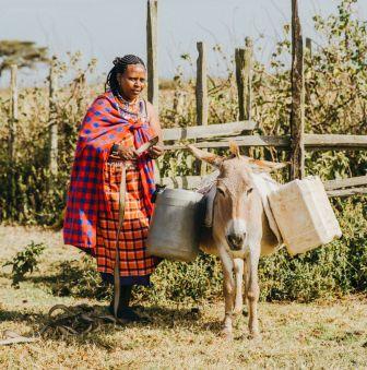 donkey woman kenya water CROPPED AND SMALL.jpg