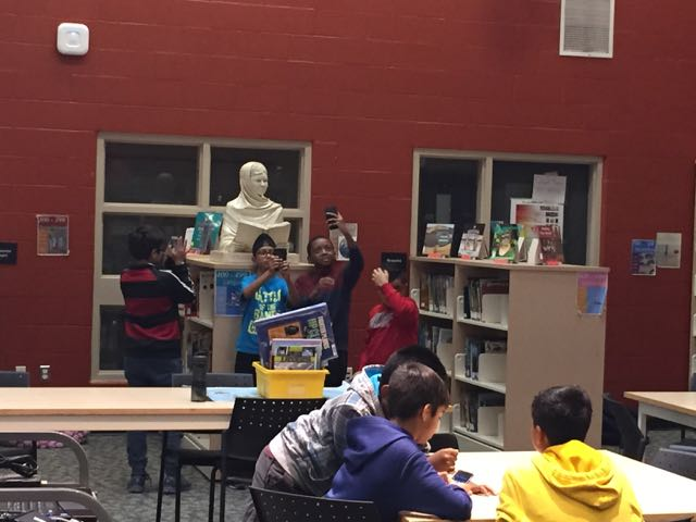 Malala sculpture at home in the Lougheed Middle School library