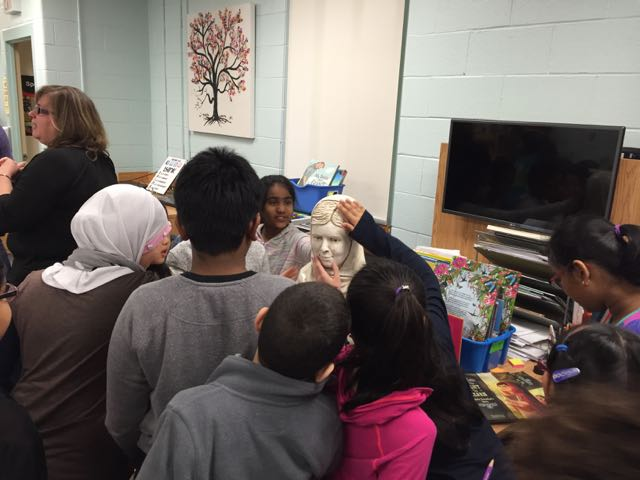 Students at Floradale Public School interacting with their Malala sculpture