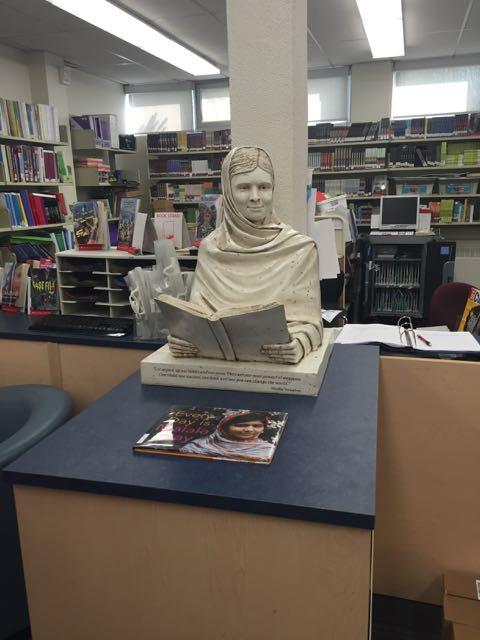 Malala sculpture at home in the Allan A Martin Sr. Public School library