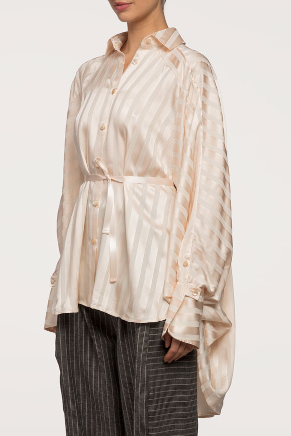 the Streep Shirt  - The Streep shirt took on its name by one of the best actresses of our time; Meryl Streep. Designed with a voluminous black pleat detail, and simple front design. These attributes add to its modern shirt design.