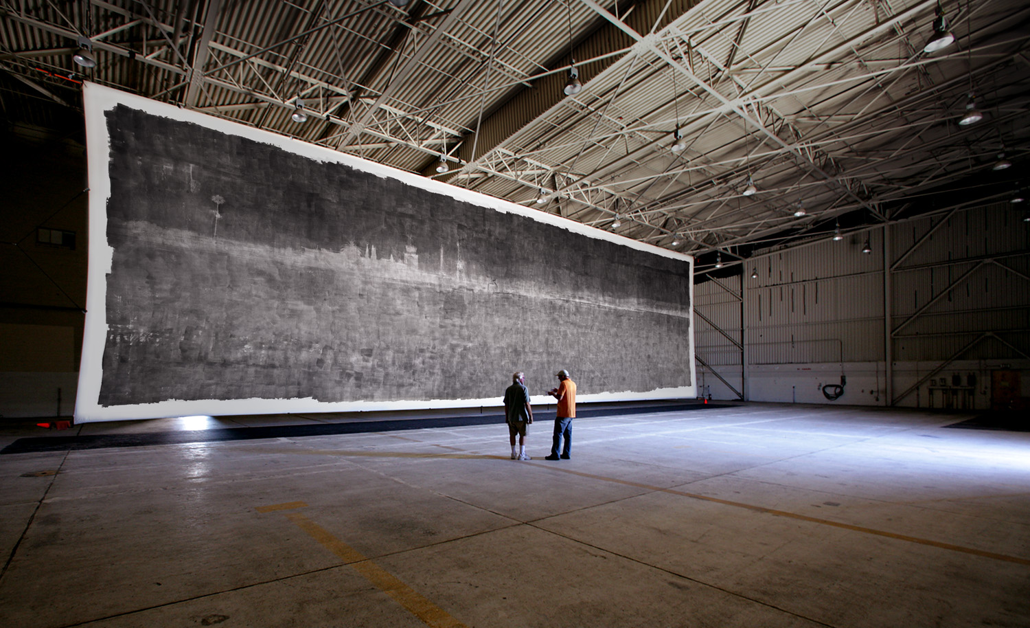The world record photograph - 32 feet by 111 feet - in place in the closed F-18 jet hanger used as a camera to make the image.