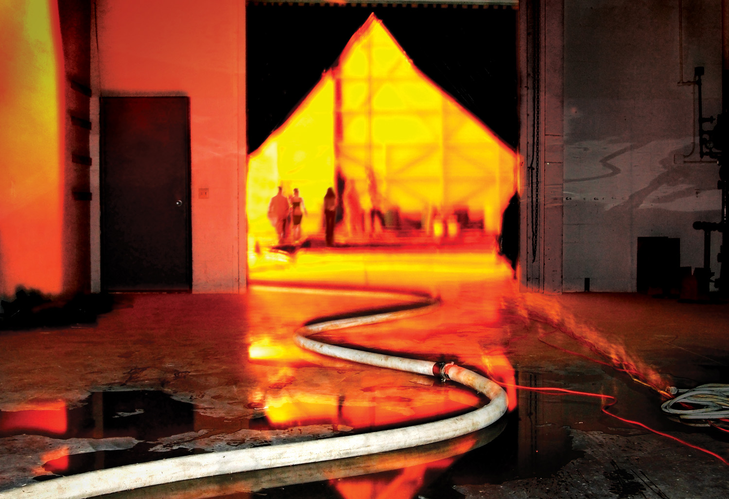 Two fire hoses were used to wash the Great Picture on the evening of development. Temperatures exceeded 100 degrees and the fumes from the chemistry were at times overwhelming.