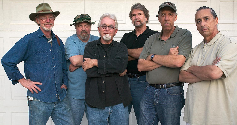 Partner's-in-crime: l to r - Mark Chamberlain, Rob Johnson, Jerry Burchfield, Jacques Garnier, Douglas McCulloh, Clayton Spada.