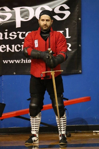 Jayson Barrons - Jayson cut his HEMA teeth with Tristan Zukowski at NYHFA, before moving to Denver. Here he is one of the instructors at the Denver Historical Fencing Academy. He also trains in epee for the purpose of honing technique as well as fencing strategy. Jayson is currently the President of the HEMA Alliance and Editor of measureandweigh.com. .