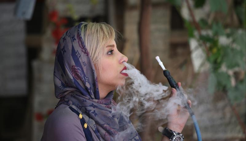 A woman smokes a hookah in Shiraz. Photo: John Moore/Getty Images